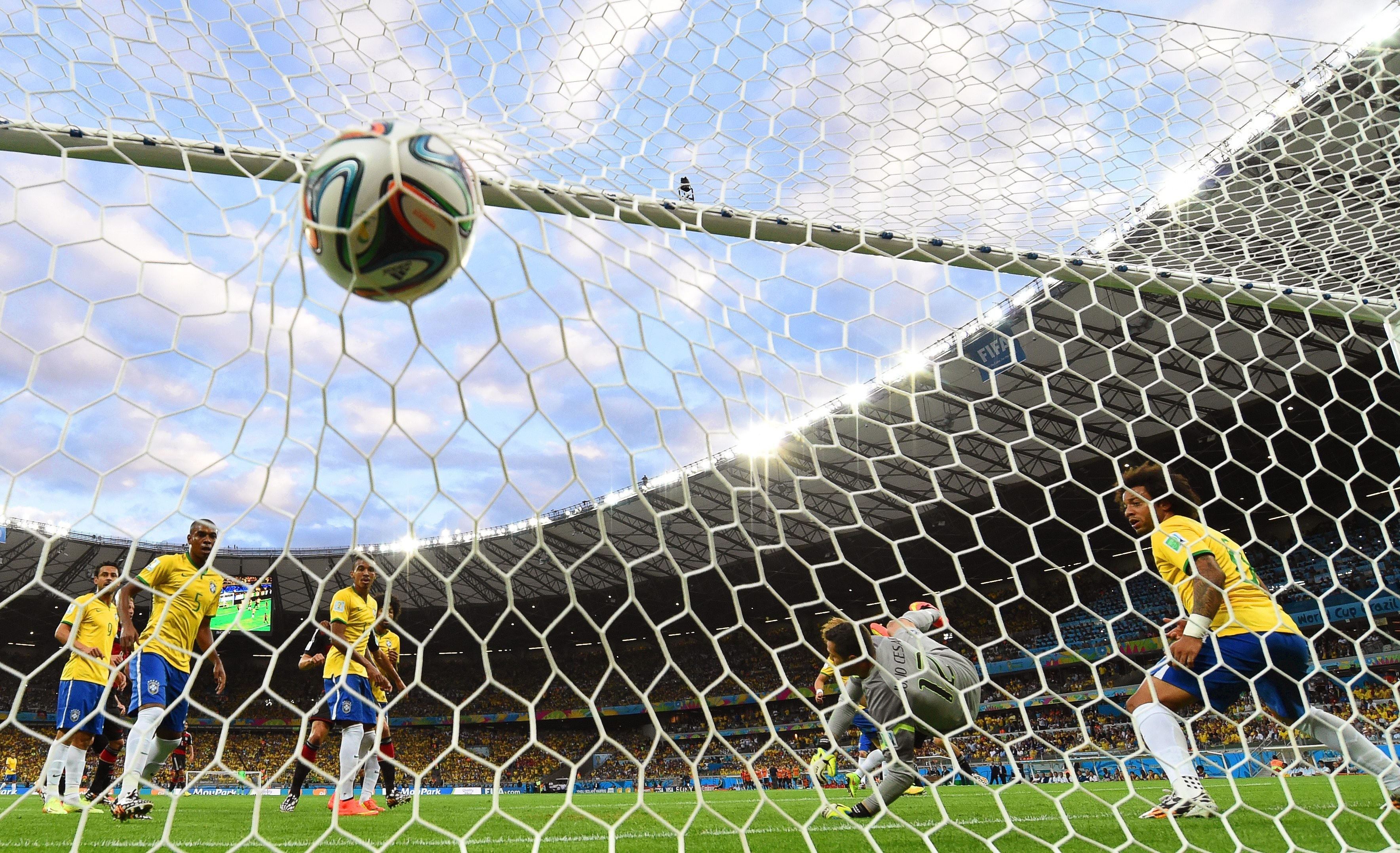 Brazil's goalkeeper Julio Cesar receives the opening goal during the match between Brazil and Germany at the Estadio Mineirao in Belo Horizonte, Brazil on July 8, 2014.