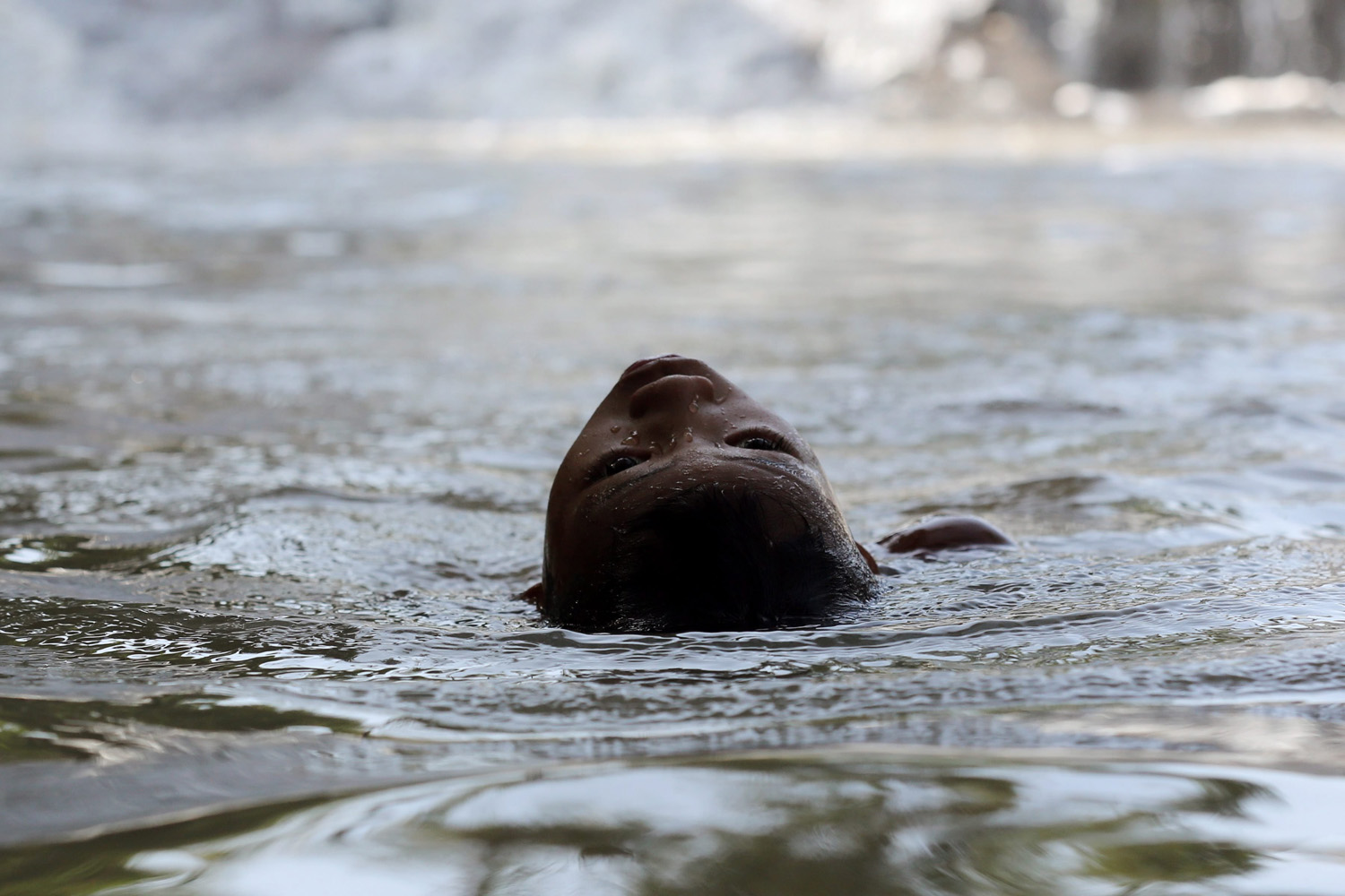 Jul. 18, 2014. A Filipino boy in water at a flood control facility in Las Pinas city, south of Manila, Philippines.