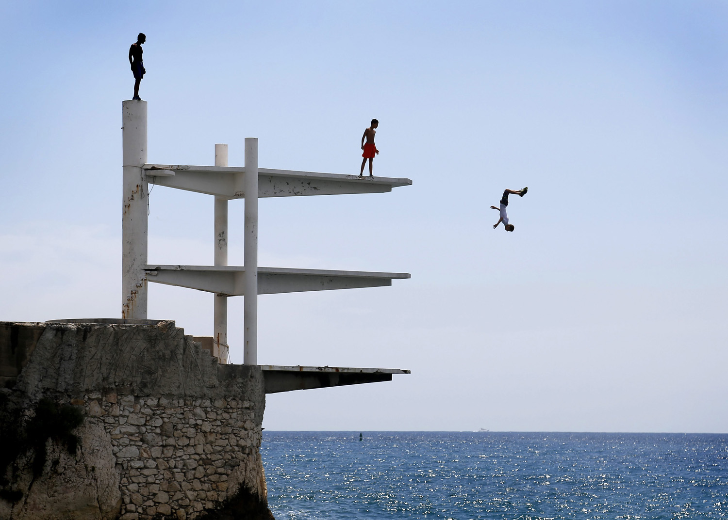 People dive into the Mediterranean Sea on a hot summer's day in Nice, southern France, July 21, 2014.
