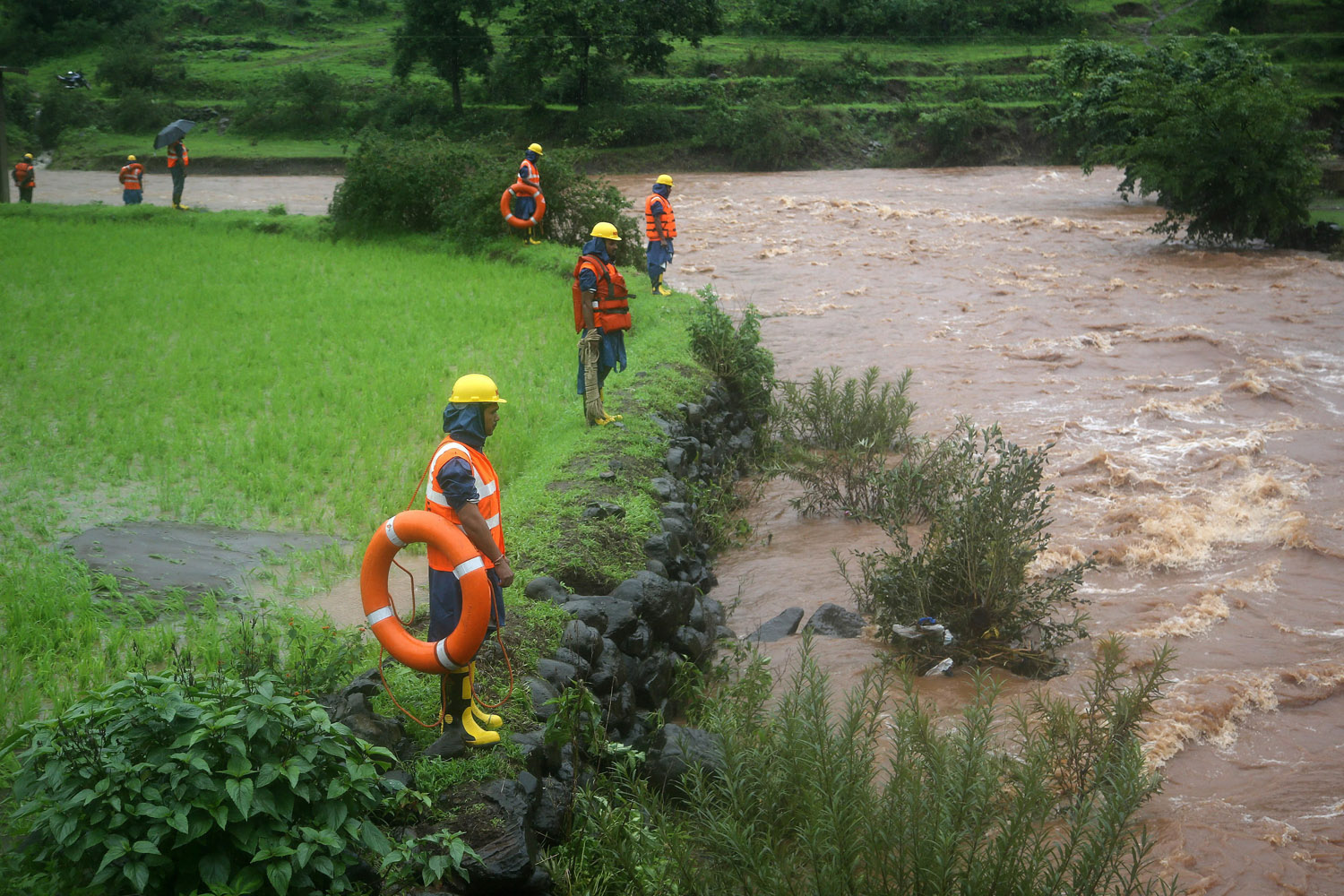 Jul. 31, 2014. An Indian National Disaster Response Force (NDRF) team looks for dead bodies in the river after a landslide in Malin village, Pune district, Maharashtra, India.
