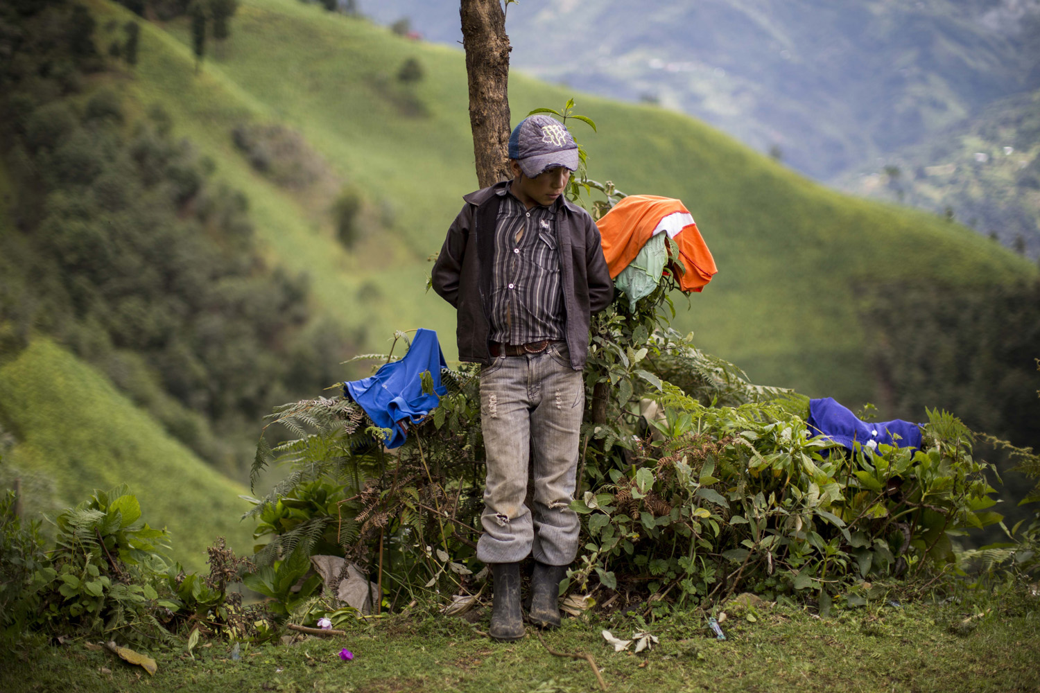 Jul. 1, 2014. Gilberto Haroldo Ramos Juarez, 11, brother of Gilberto Francisco Ramos Juarez, a Guatemalan boy whose decomposed body was found in the Rio Grande Valley of South Texas, stands in front of his home in San Jose Las Flores, in the northern Cuchumatanes mountains of Guatemala.