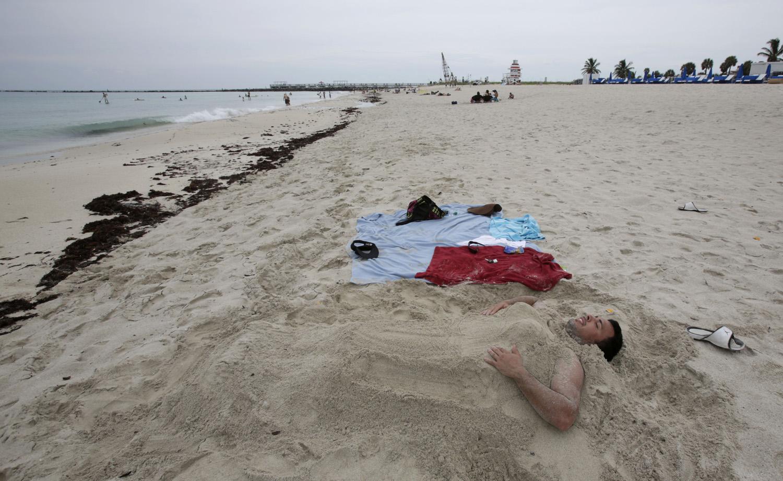 Nick Alvarez, of New York, enjoys a day at the beach in Miami Beach, Fla. on July 1, 2014.