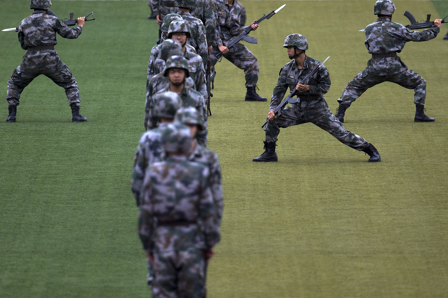 Jul. 22, 2014. Chinese People's Liberation Army cadets conduct a bayonet drill at the PLA's Armoured Forces Engineering Academy Base, in the outskirt of Beijing, China.