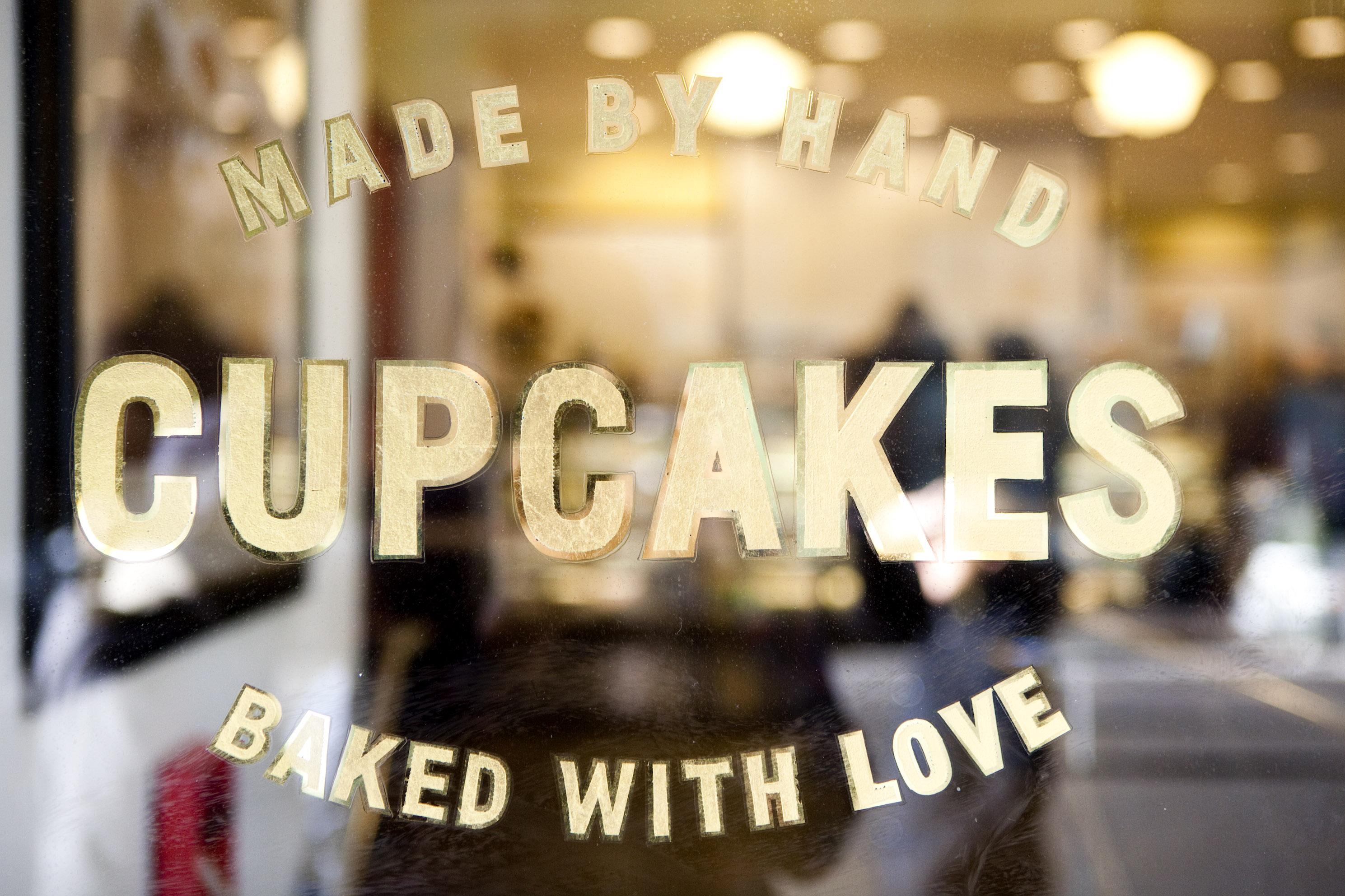 A sign advertises hand-baked cupcakes at a Crumbs cupcake store in New York, U.S., on Thursday, Jan. 13, 2011.