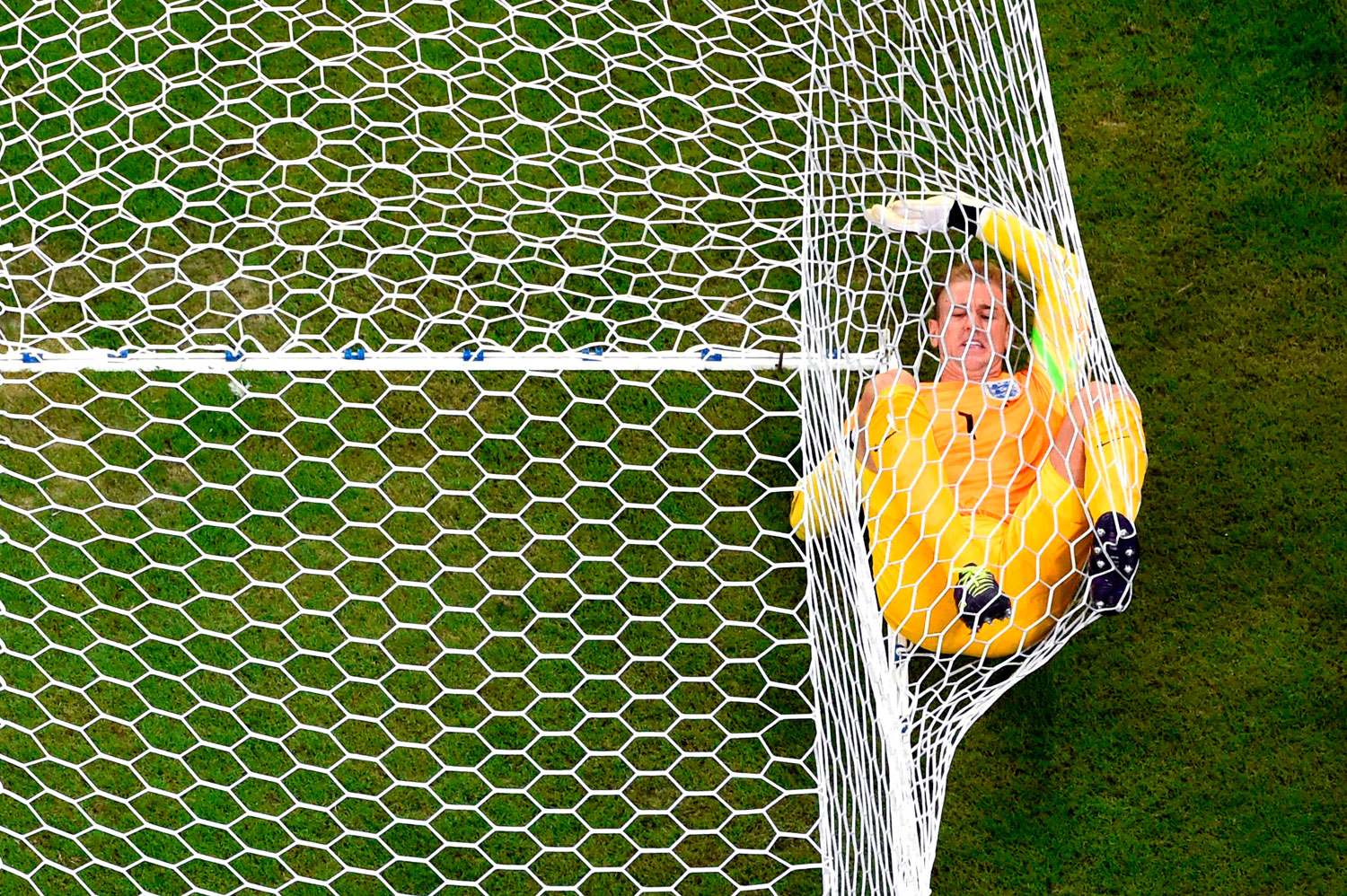 Joe Hart of England lands in the net after allowing Italy's second goal to Mario Balotelli of Italy during the match between England and Italy at Arena Amazonia on June 14, 2014 in Manaus, Brazil.