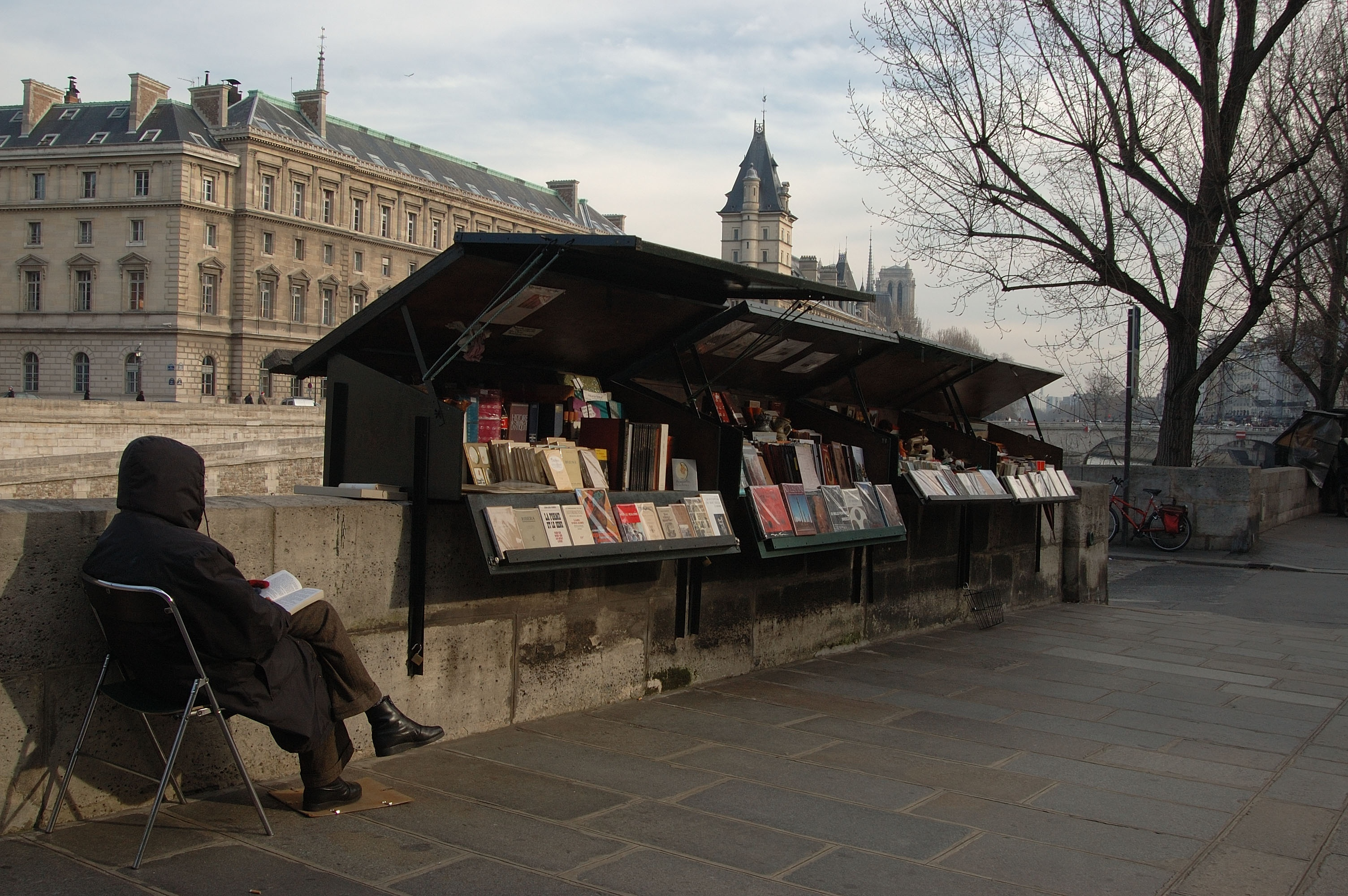 Booksellers on the banks of the Seine opposite the Ile de la Cite in Paris, France in February, 2006.