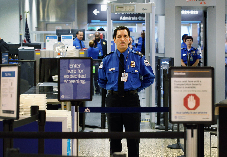 A TSA agent waits for passengers to use the TSA PreCheck lane at Miami International Airport on October 4, 2011.