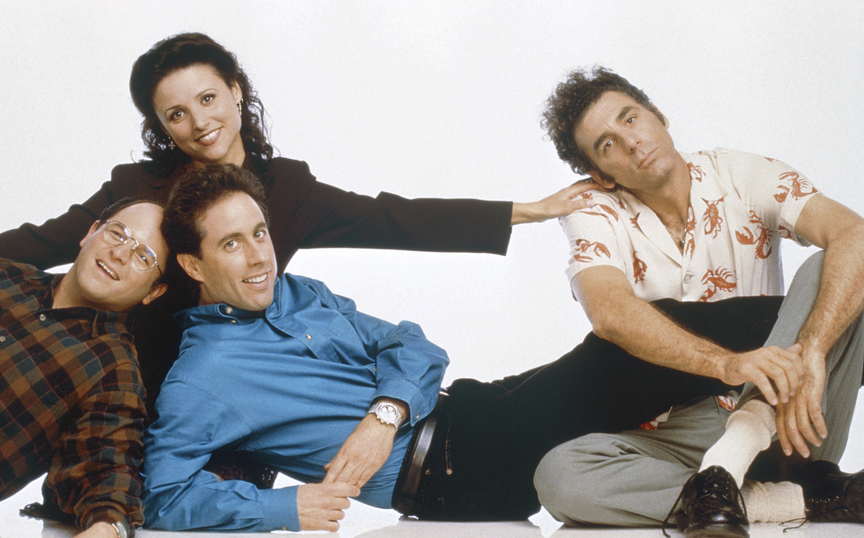 Jason Alexander as George Costanza, Julia Louis-Dreyfus as Elaine Benes, Jerry Seinfeld as Jerry Seinfeld and Michael Richards as Cosmo Kramer