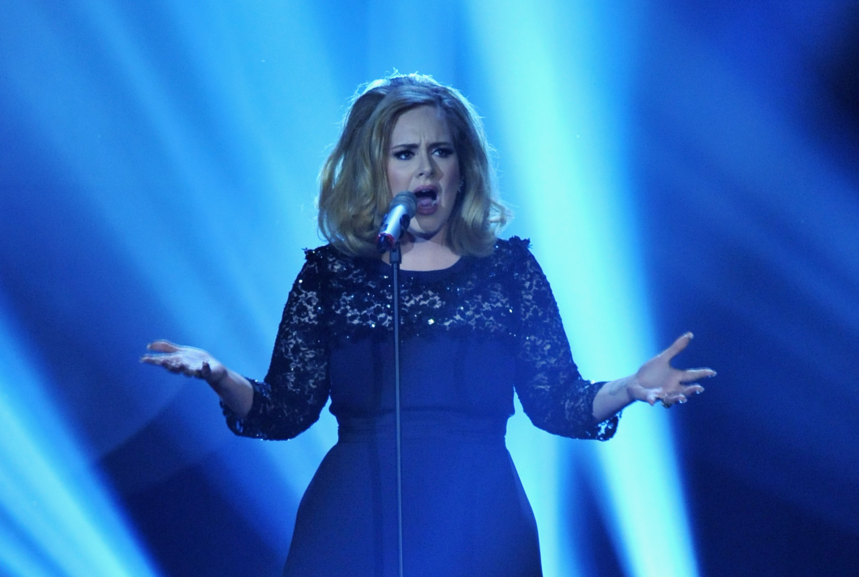 Barely-pregnant Adele performs during The BRIT Awards 2012
