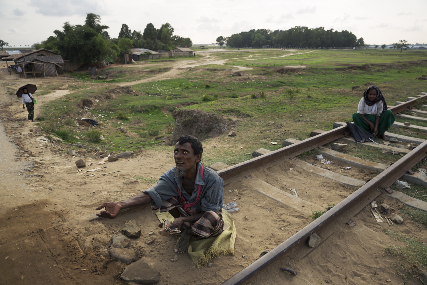 A blind beggar on railway tracks between two IDP camps.