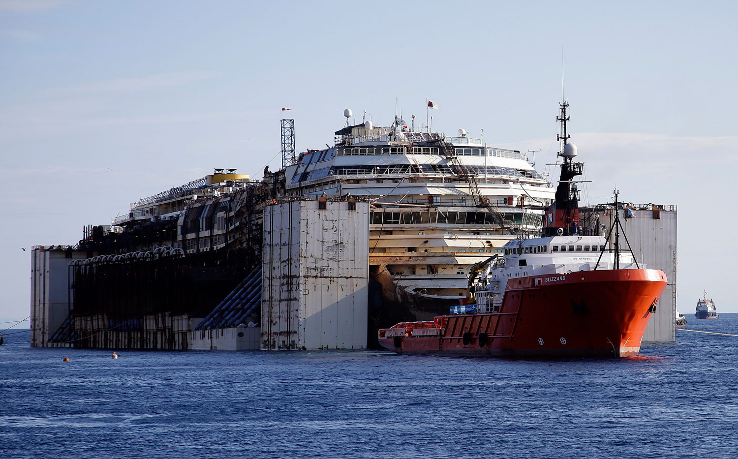 Costa Concordia is maneuvered into position to be towed away from the tiny Tuscan island of Isola del Giglio, Italy on July 23, 2014.