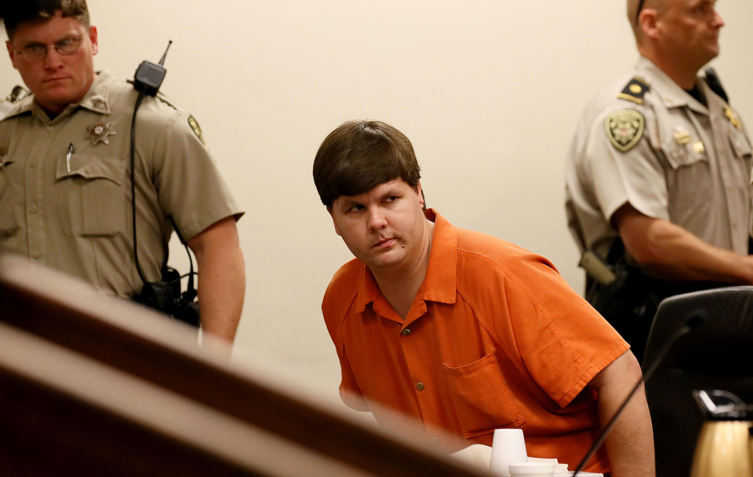 Justin Ross Harris, the father of a toddler who died after police say he was left in a hot car for about seven hours, is escorted out of Cobb County Magistrate Court after he was denied bond, Thursday, July 3, 2014, in Marietta, Ga.