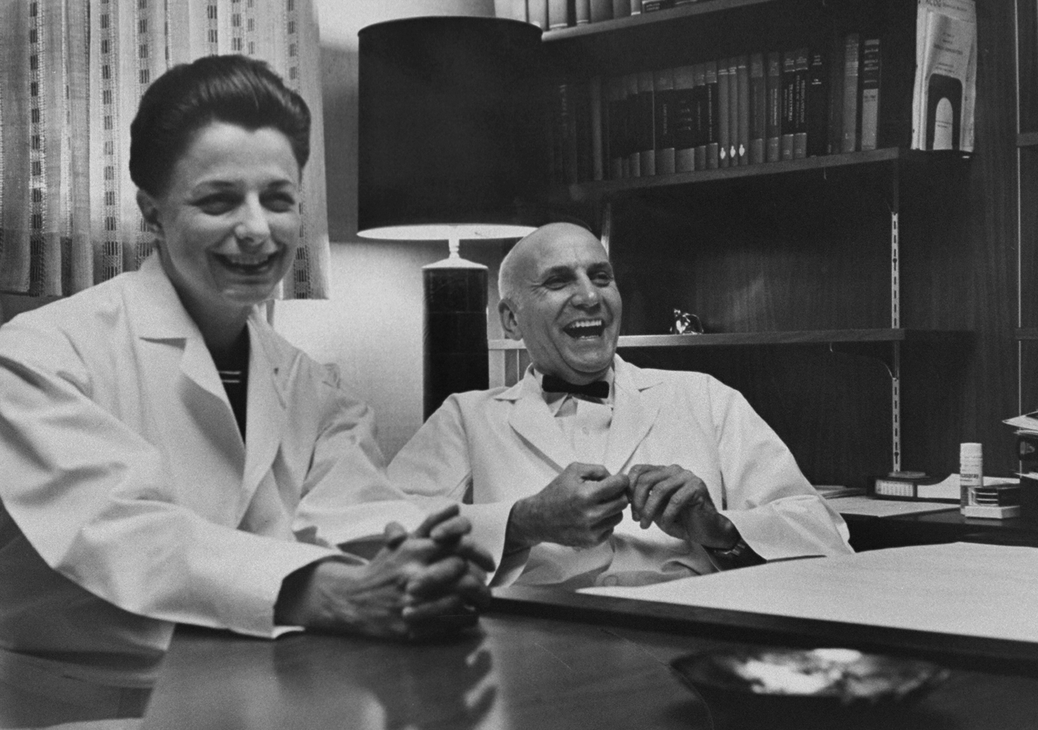 Caption from LIFE.  Mrs. Johnson and Dr. Masters enjoy a break from grueling work schedule. Says Mrs. Johnson: 'Dr. Masters is an incredibly funny man, He's a superb mime. And his humor is very subtle. He makes a joke, and five minutes later I begin to crack up.'