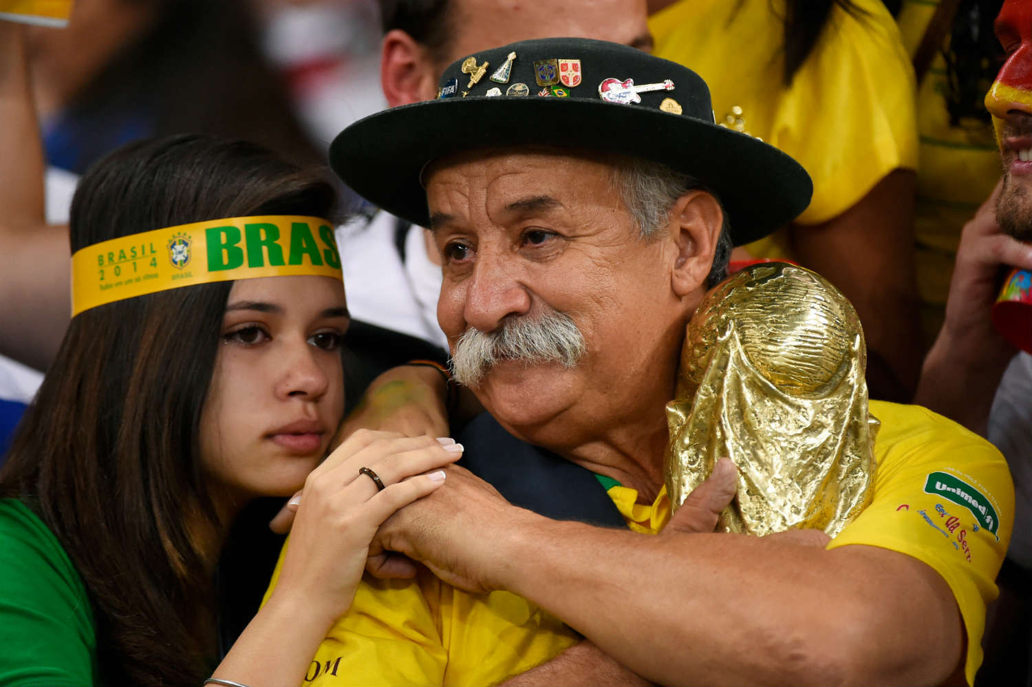 Brazilian fans react with sorrow as their team goes down in the World Cup semi-final