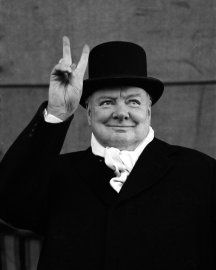 "British Prime Minister Winston Churchill flashes his trademark ""V for Victory"" sign, 1951."