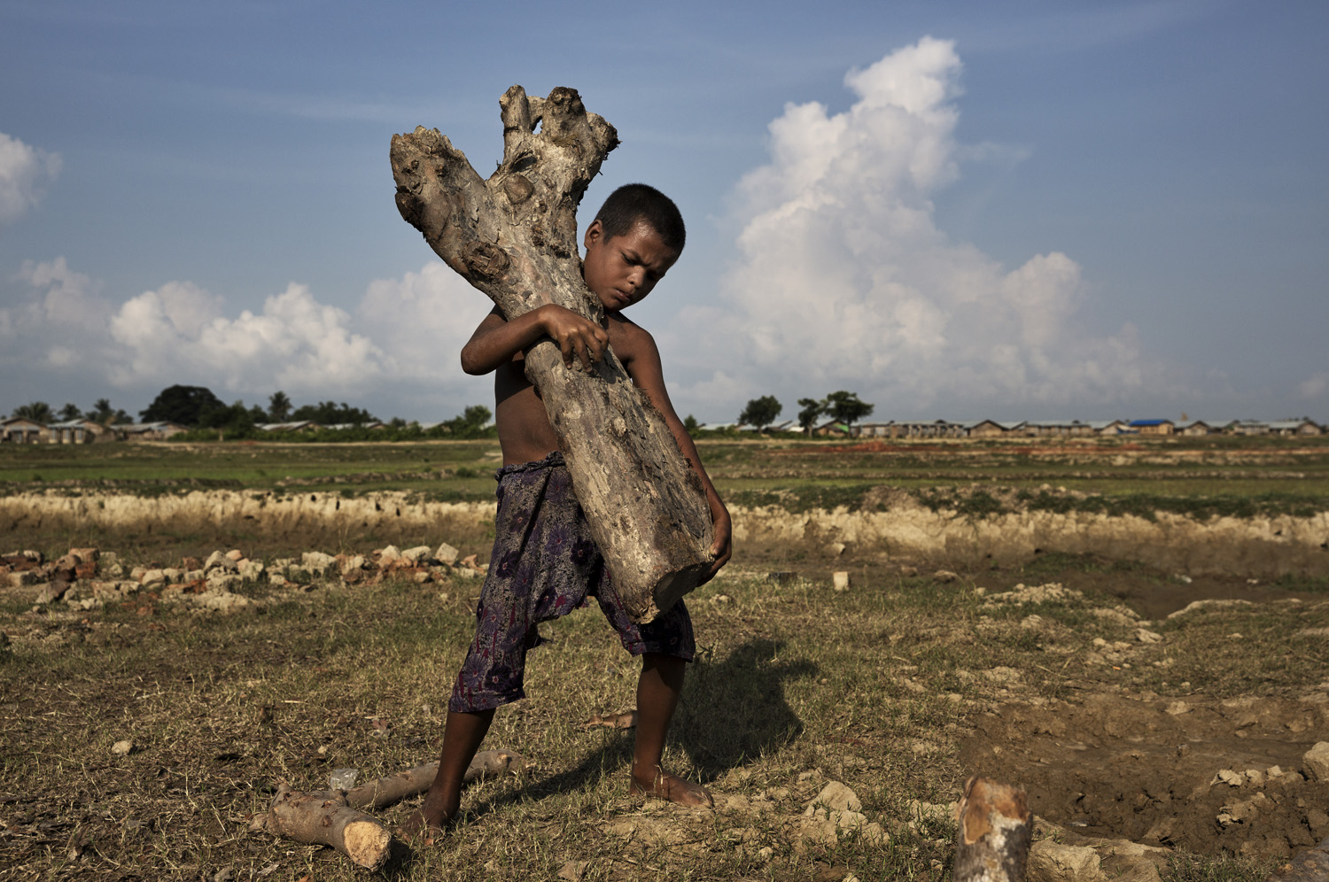 Thek Kay Pyin, 7, is among the Rohingya Muslims interned in Rakhine state,                                   on the northwest coast of Burma. He is seen here working at a brick kiln where he earns $1 a day.