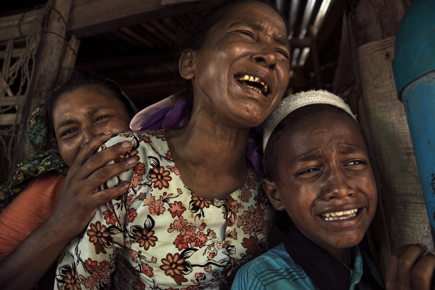 Relatives weep at the funeral of a woman who died at 35 of a stomach disease; she left five children behind.