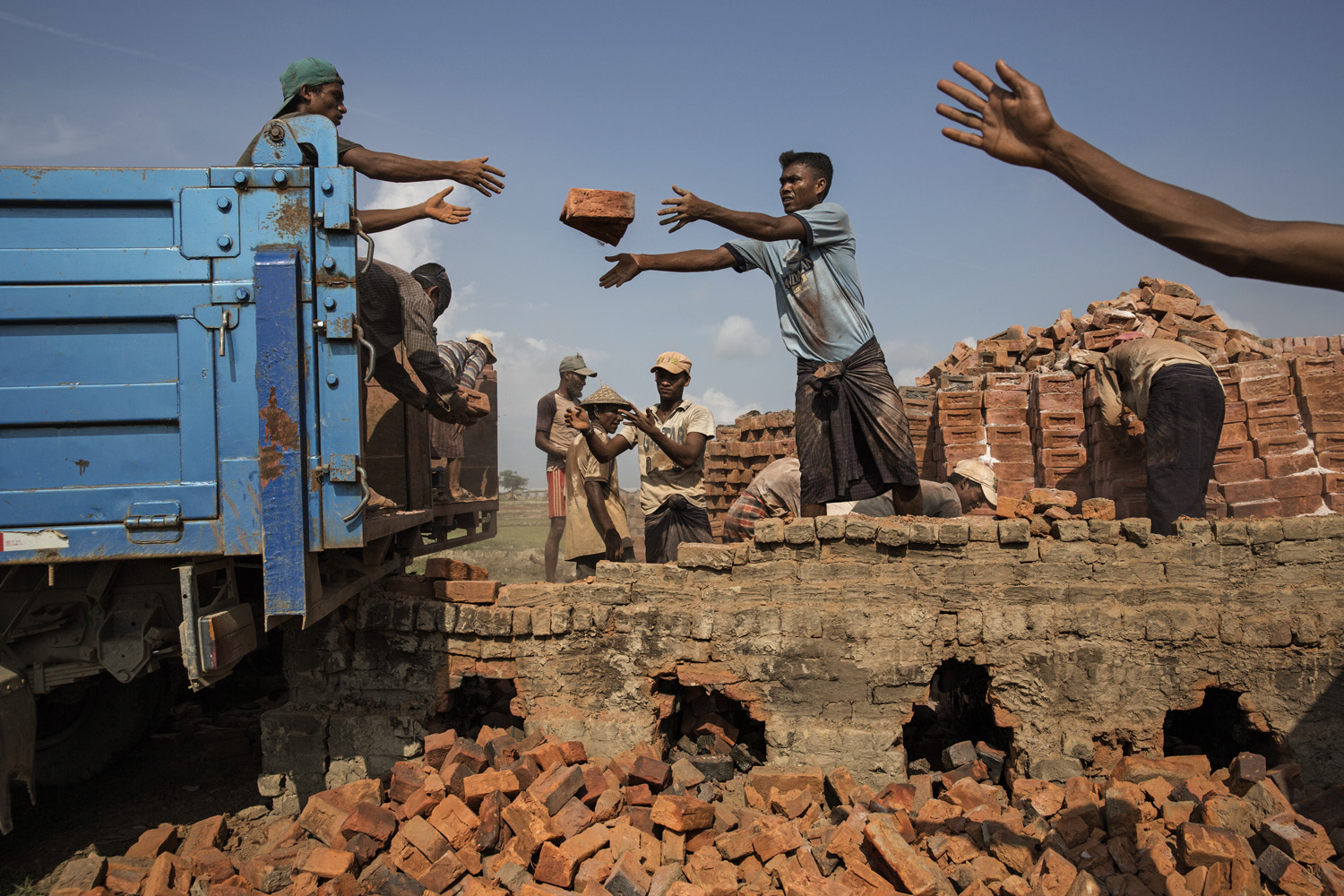 Internees in one camp operate brick kilns to earn money. Adults are paid about $2 a day; children, half that amount.