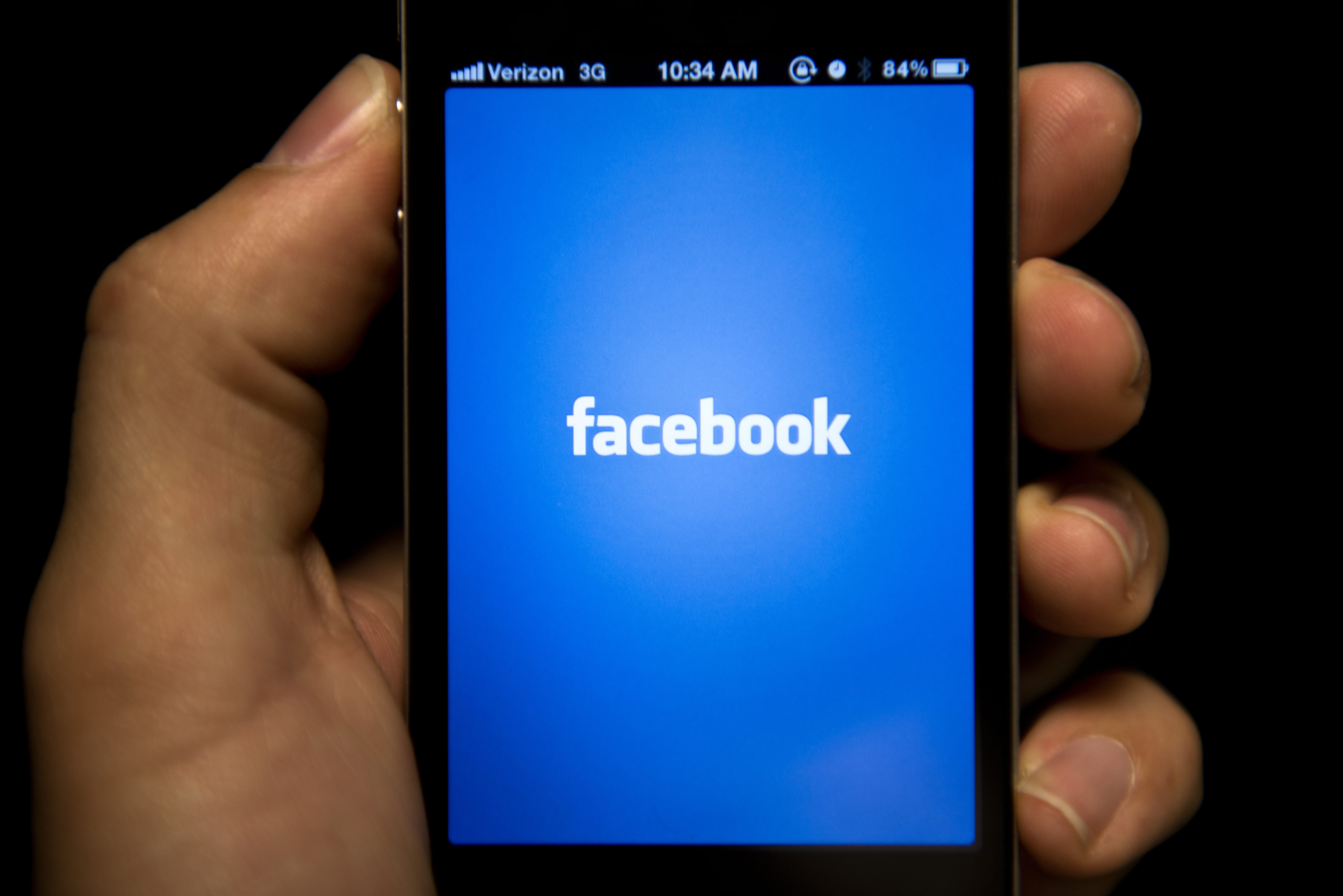 A view of an Apple iPhone displaying the Facebook app's splash screen, May 10, 2012 in Washington.