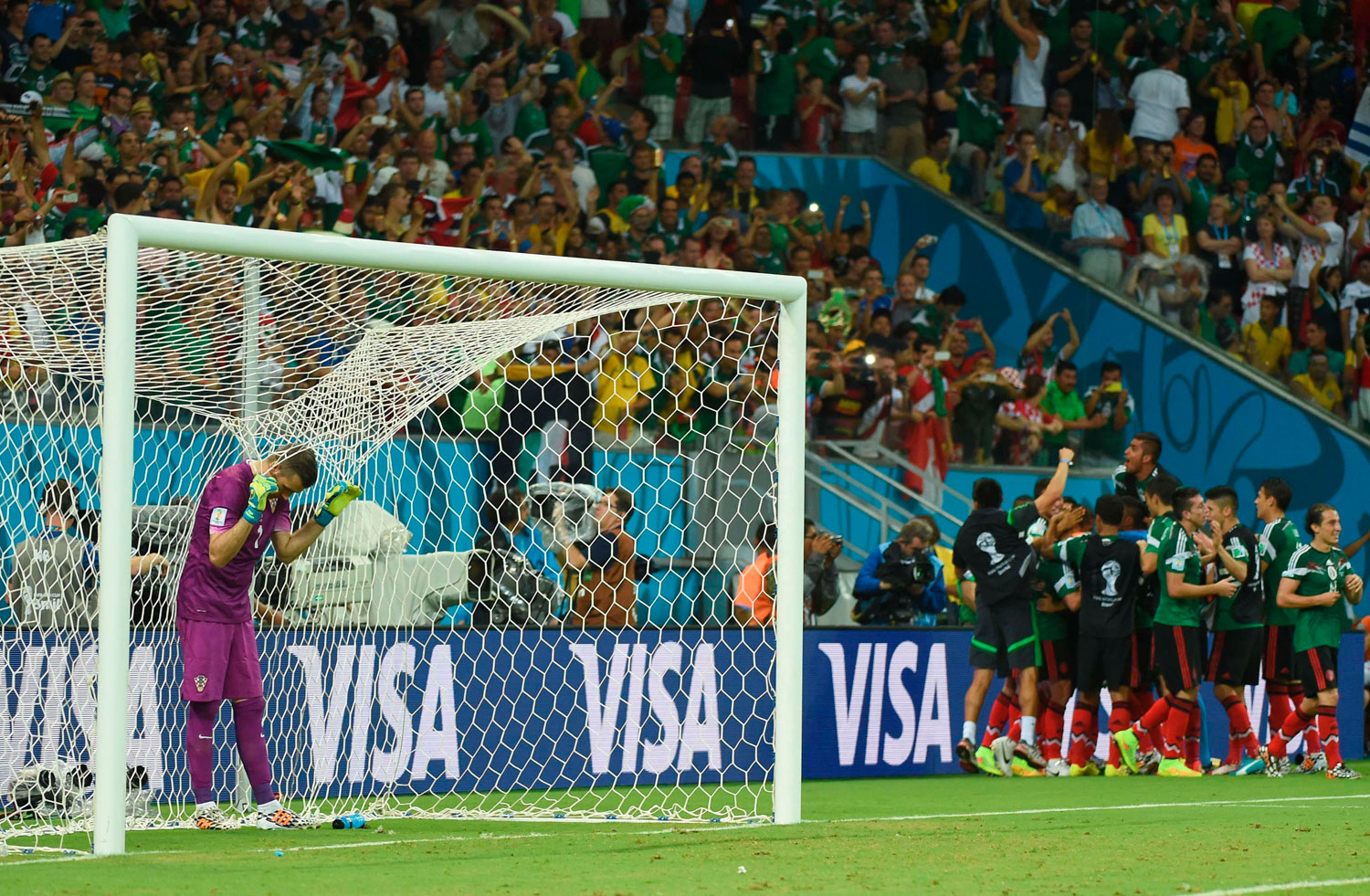 Croatia's goalkeeper Stipe Pletikosa reacts after Mexico scored in a match between Croatia and Mexico at the Pernambuco Arena in Recife, Brazil on June 23, 2014.