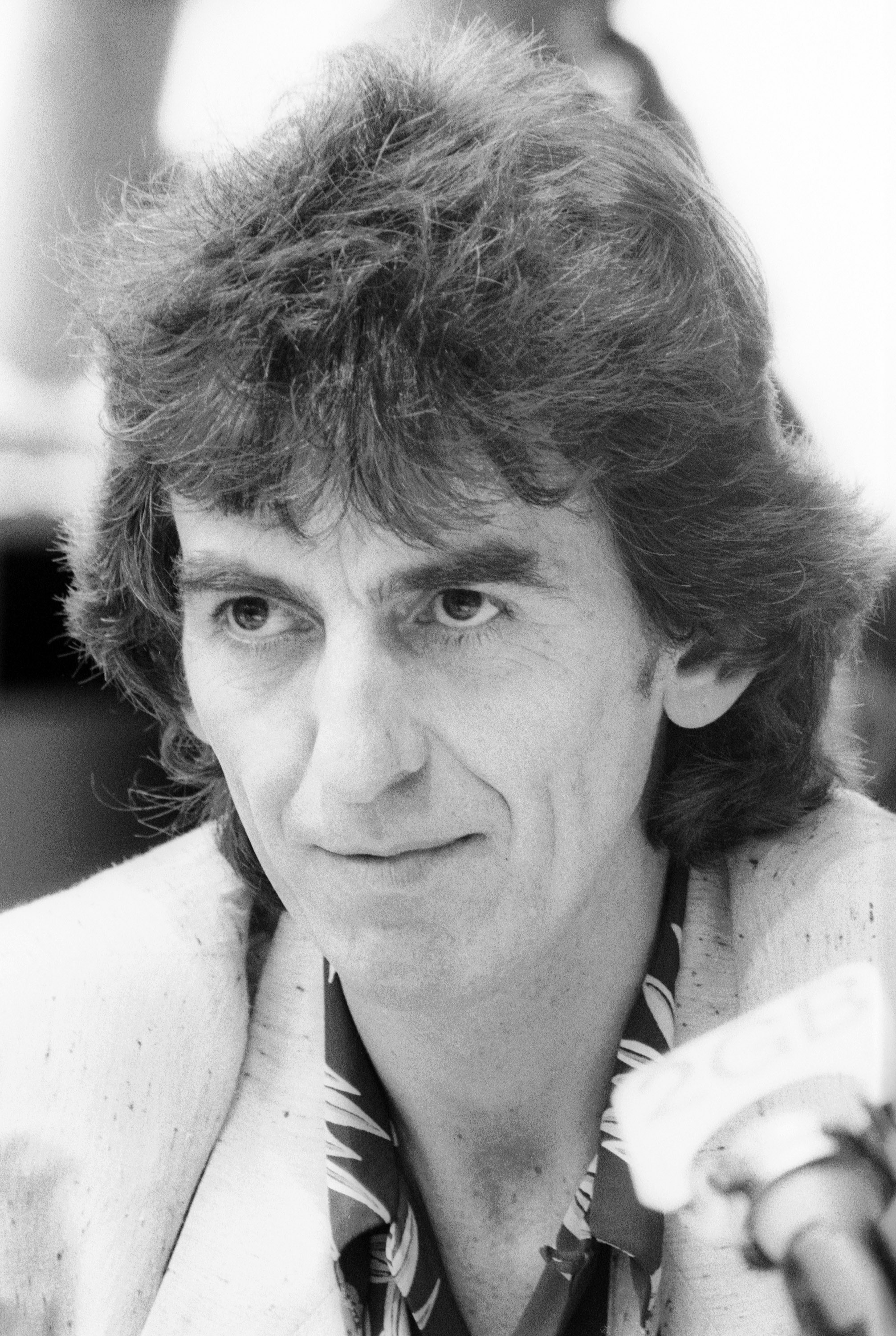 Musician and former member of 'The Beatles' George Harrison attends a press conference to launch the new book by Derek Taylor 'Fifty Years Adrift' at the Sydney Opera House on November 30, 1984