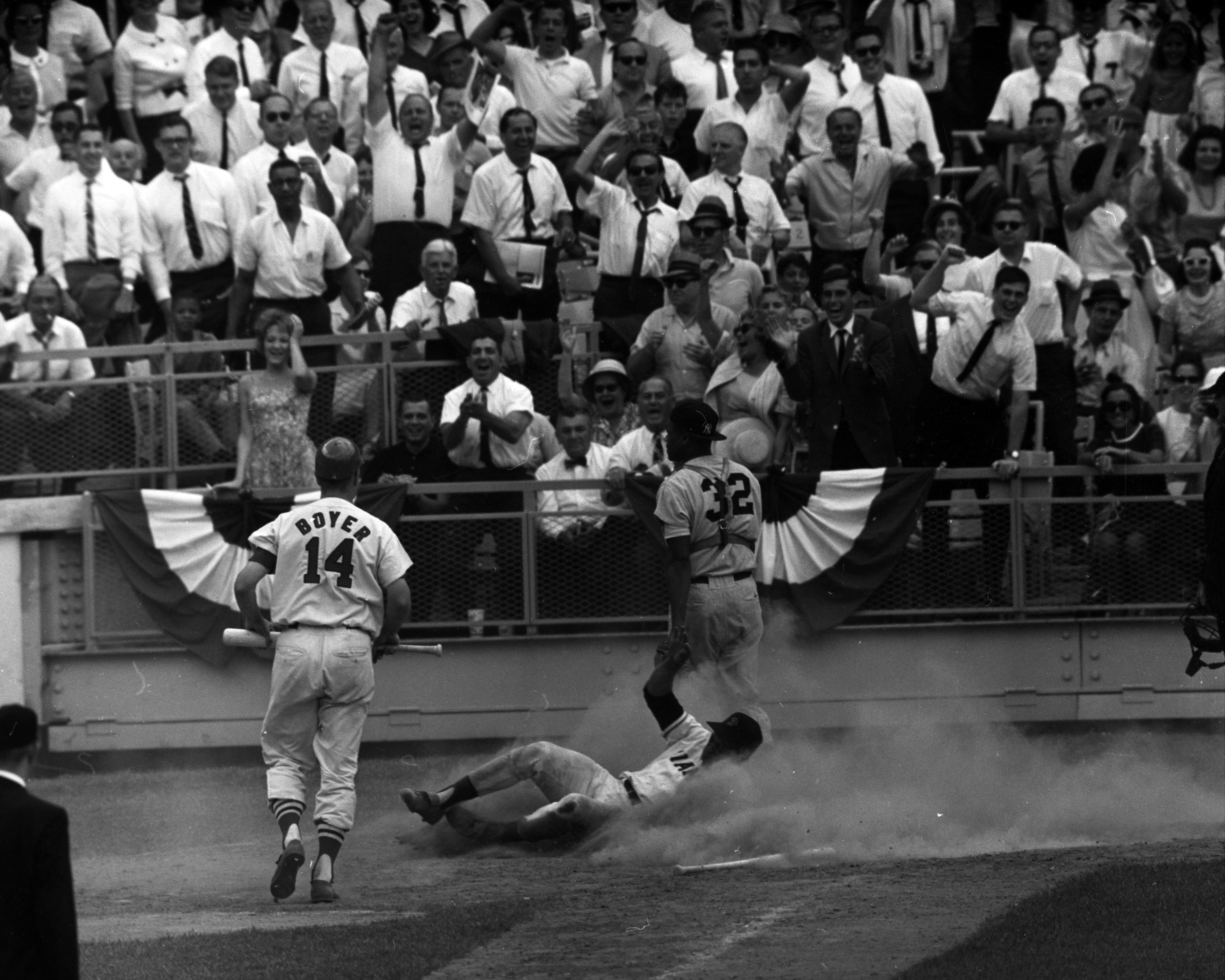 Baseball All-Star Game 1964 - Willie is home in a game-tying cloud of dust. Howard looks at throw from Joe Pepitone: it bounced out of control on hard infield.   (Photo By: Charles Hoff/NY Daily News via Getty Images)