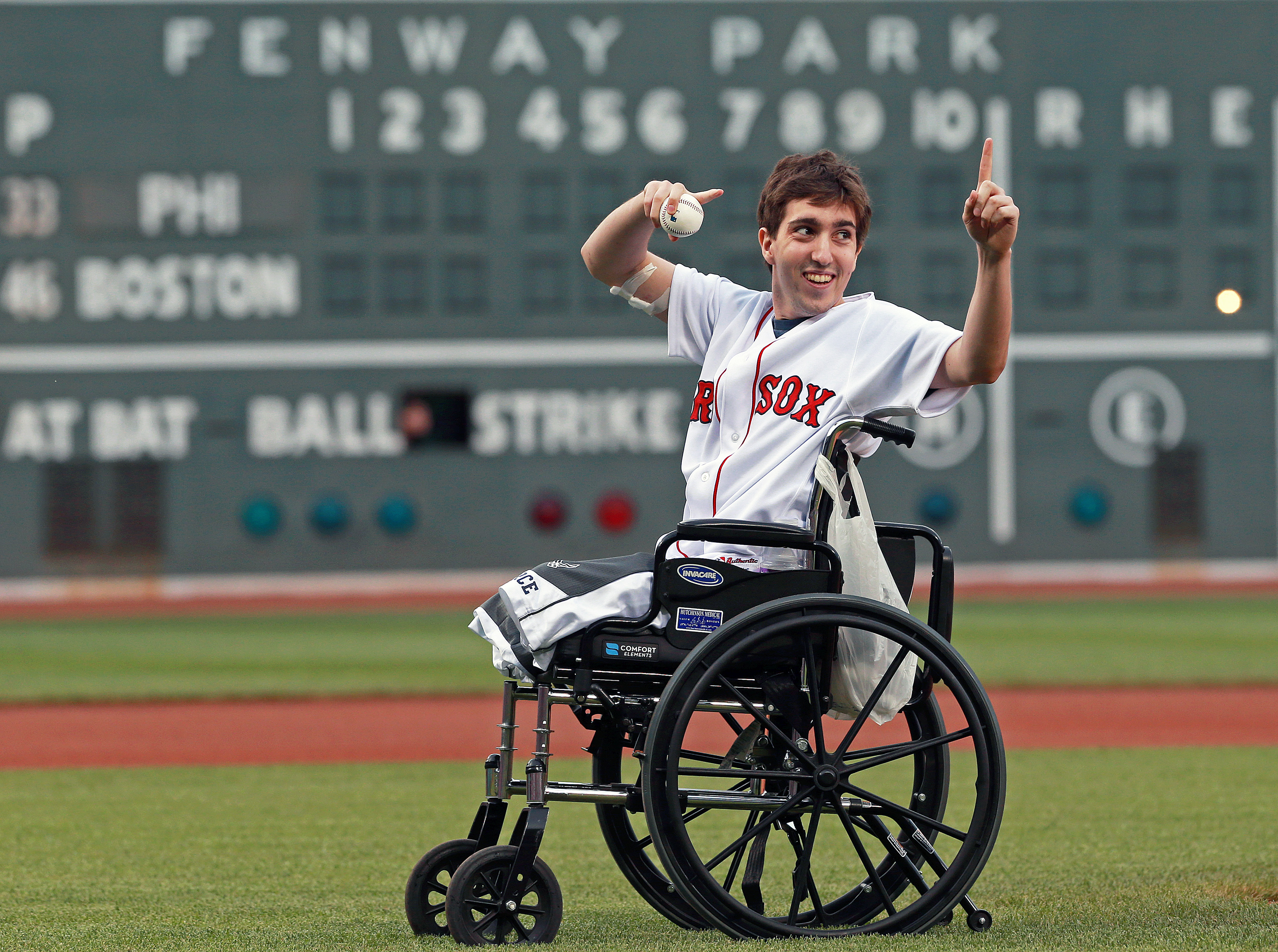 Boston Marathon bombing victim Jeff Bauman threw out a ceremonial first pitch on May 28, 2013, at Boston's Fenway Park, where the Philadelphia Phillies played the Red Sox in a regular-season baseball game.