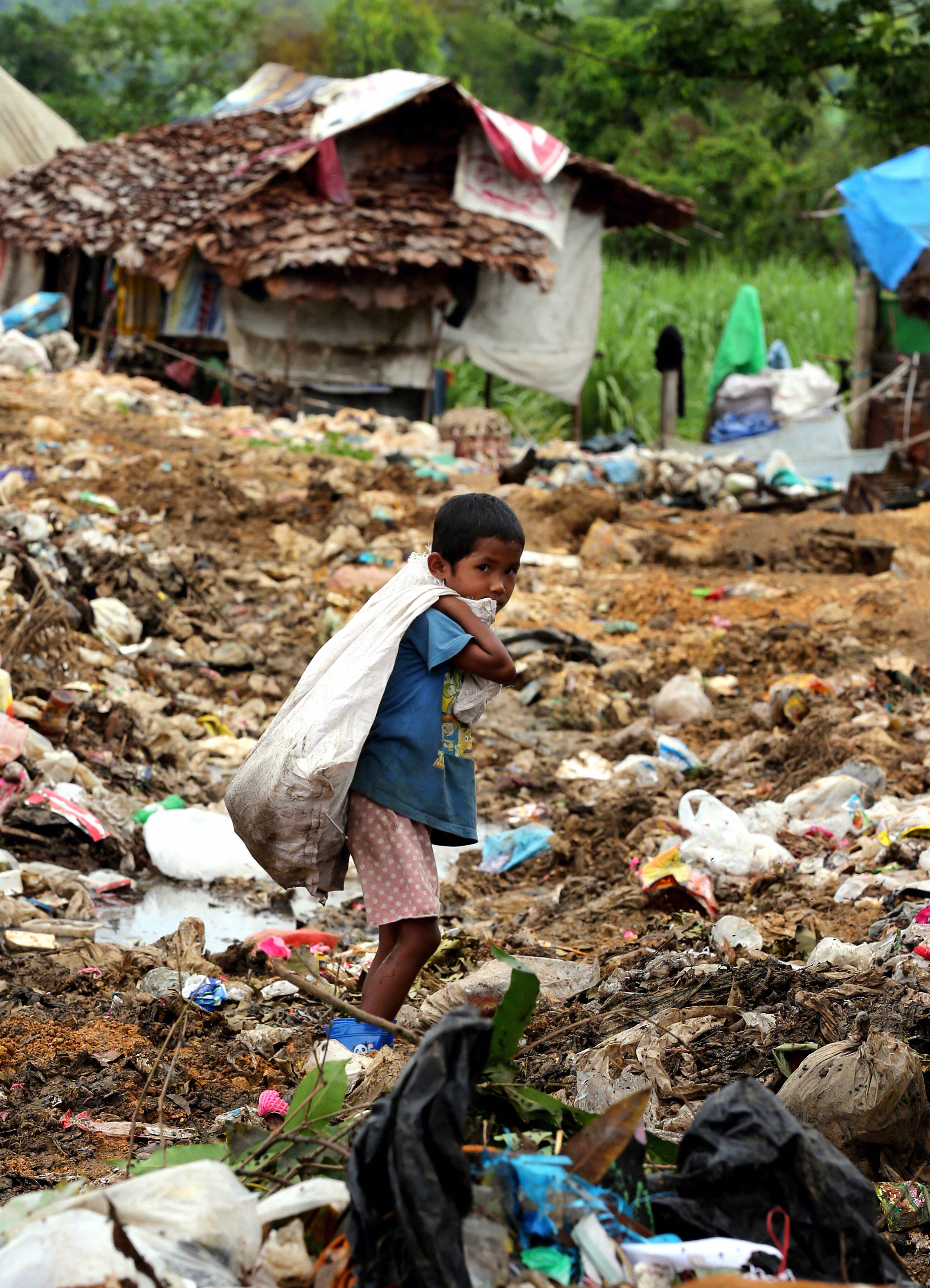 An illegal-immigrant boy from Burma works at mountains of rubbish in Mae Sot, Thailand, on July 18, 2013
