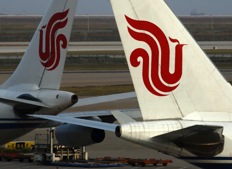 Air China aircraft stand parked at Shanghai Pudong International Airport in Shanghai, China, on Saturday, Oct. 26, 2013.