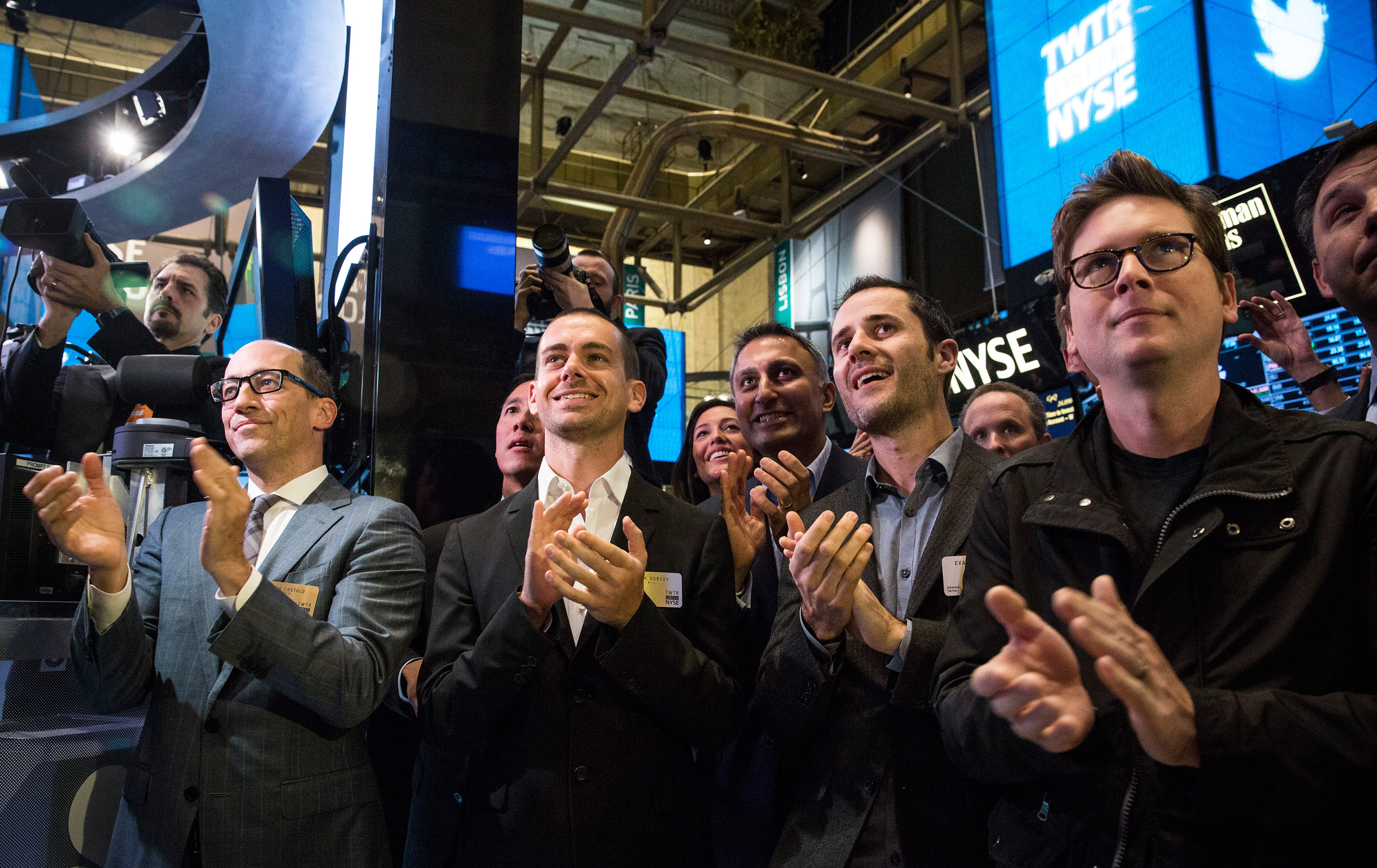 (L-R) Twitter CEO Dick Costolo, Twitter co-founder Jack Dorsey, Twitter co-founder Evan Williams and Twitter co-founder Biz Stone applaud as Twitter rings the opening bell at the New York Stock Exchange (NYSE) while also celebrating the company's IPO on November 7, 2013 in New York City.