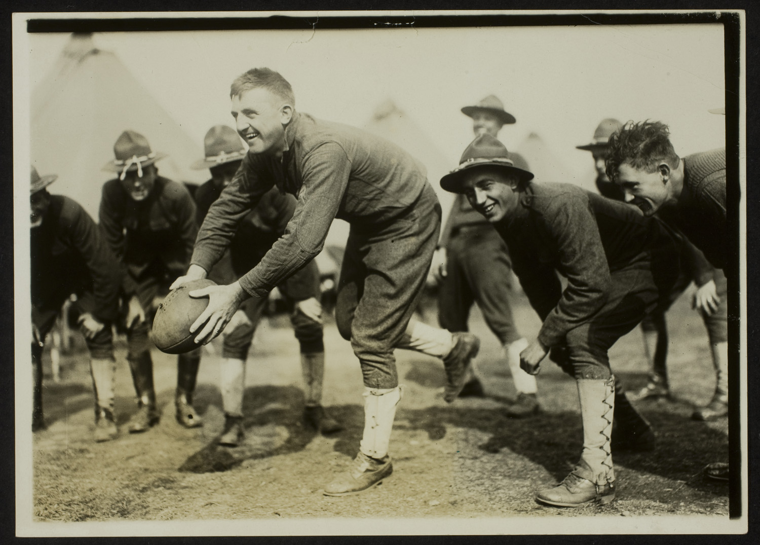 Soldiers playing football, Army training camp, 1917                                                                     George Eastman House Collection, Transfer from Photo League Lewis Hine Memorial Committee, ex-collection of Corydon Hine