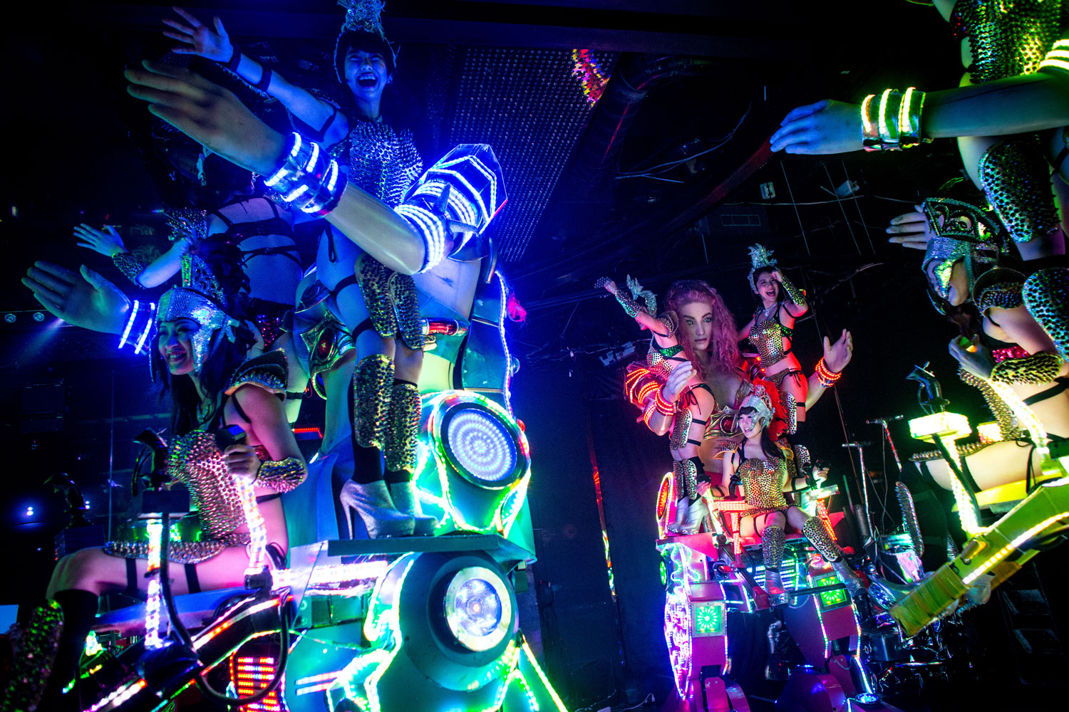 Dancers perform on large scale female robots during a show at The Robot Restaurant on June 29, 2014 in Tokyo.