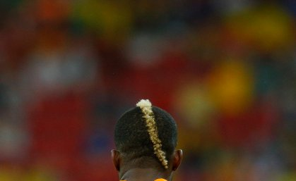 Ivory Coast's Geoffroy Serey Die is seen from the back during their match against Japan at the Pernambuco arena in Recife, Brazil on June 14, 2014.