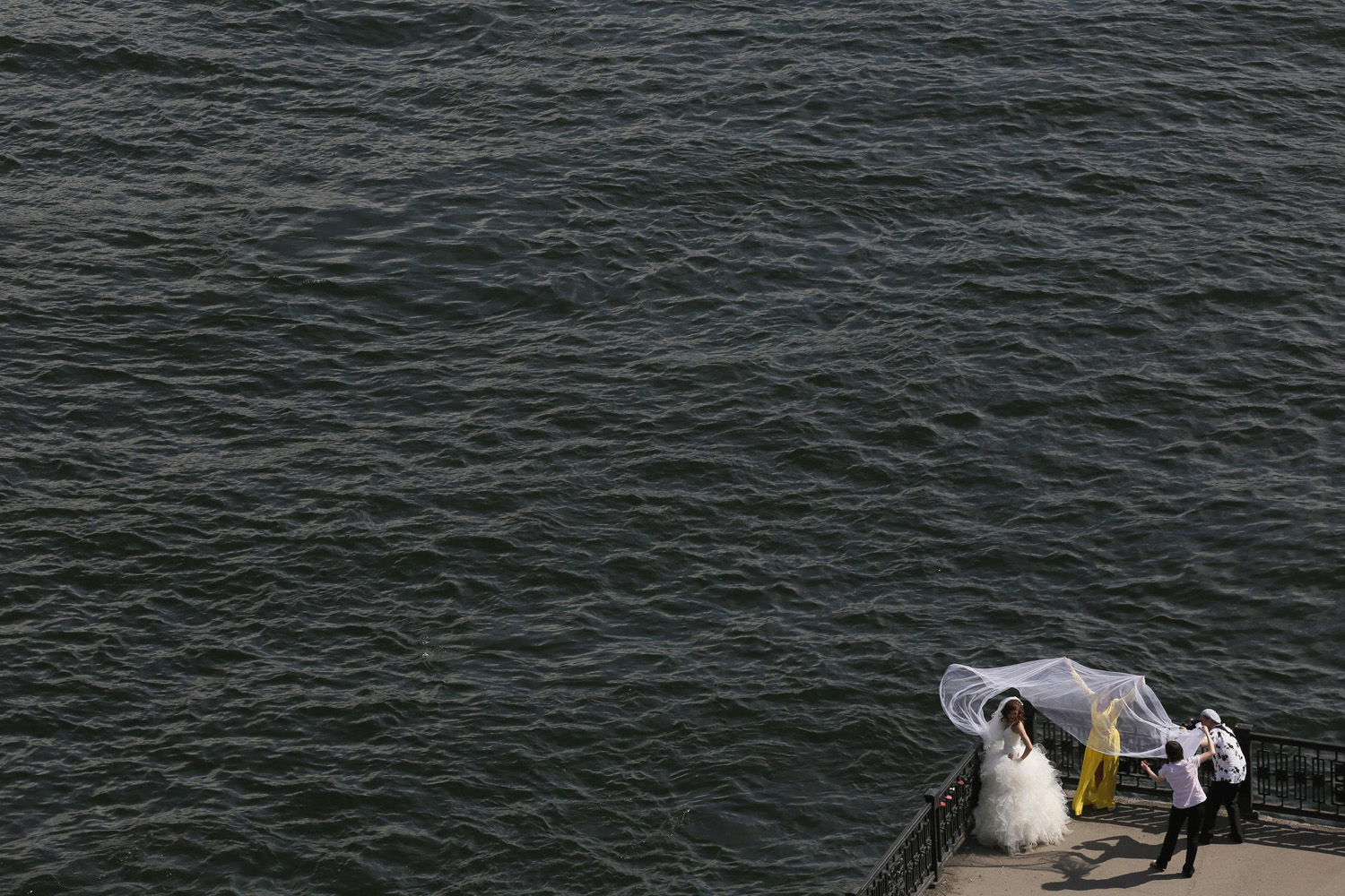 Jun. 27, 2014. A bride poses for a photographer on an embankment at the Yenisei River in Russia's Siberian city of Krasnoyarsk.