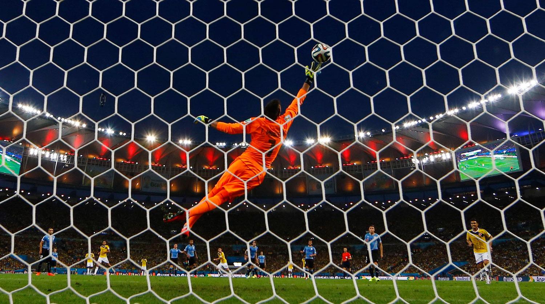 Columbia vs. Uruguay                                                              Colombia's James Rodriguez scores a goal against Uruguay's goalkeeper Fernando Muslera at the Maracana stadium in Rio de Janeiro on June 28, 2014.