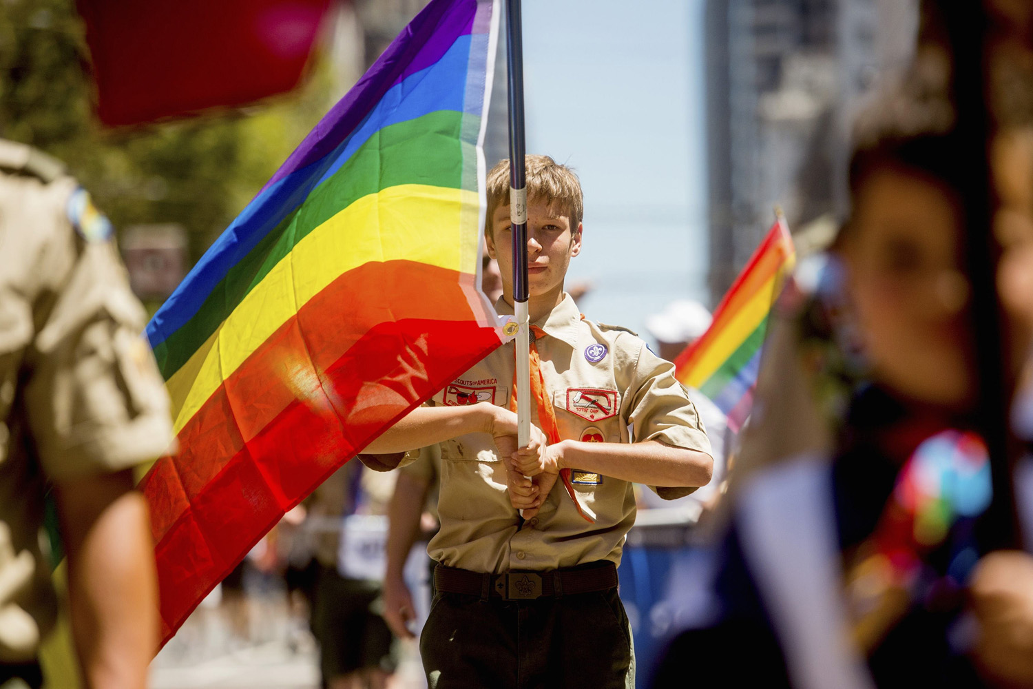 Jun. 29, 2014. Boy Scout Casey Chambers carries a rainbow flag during the San Francisco Gay Pride Festival in California.