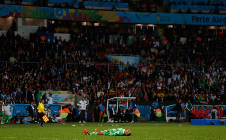 Germany vs. Algeria 2-1                                                              Algeria's Islam Slimani reacts to their loss at the Beira Rio stadium in Porto Alegre, Brazil on June 30, 2014.