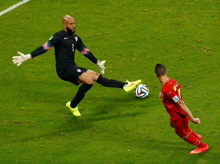 Goalkeeper Tim Howard of the U.S. blocks a shot by Belgium's Kevin Mirallas during their 2014 World Cup round of 16 game at the Fonte Nova arena in Salvador, Brazil on July 1, 2014.