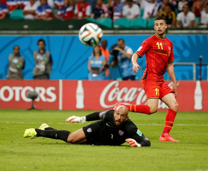 Goalkeeper Tim Howard of the U.S. eyes the ball after a save from Belgium's Kevin Mirallas during their 2014 World Cup round of 16 game at the Fonte Nova arena in Salvador, Brazil on July 1, 2014.