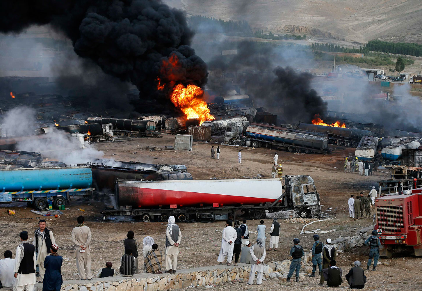 Smoke and flames rise from fuel trucks after an overnight attack by the Taliban on the outskirts of Kabul July 5, 2014.