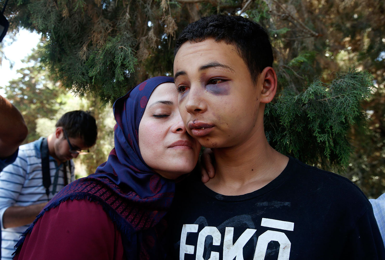 Tariq Khdeir, right, is greeted by his mother after being released from jail in Jerusalem July 6, 2014.