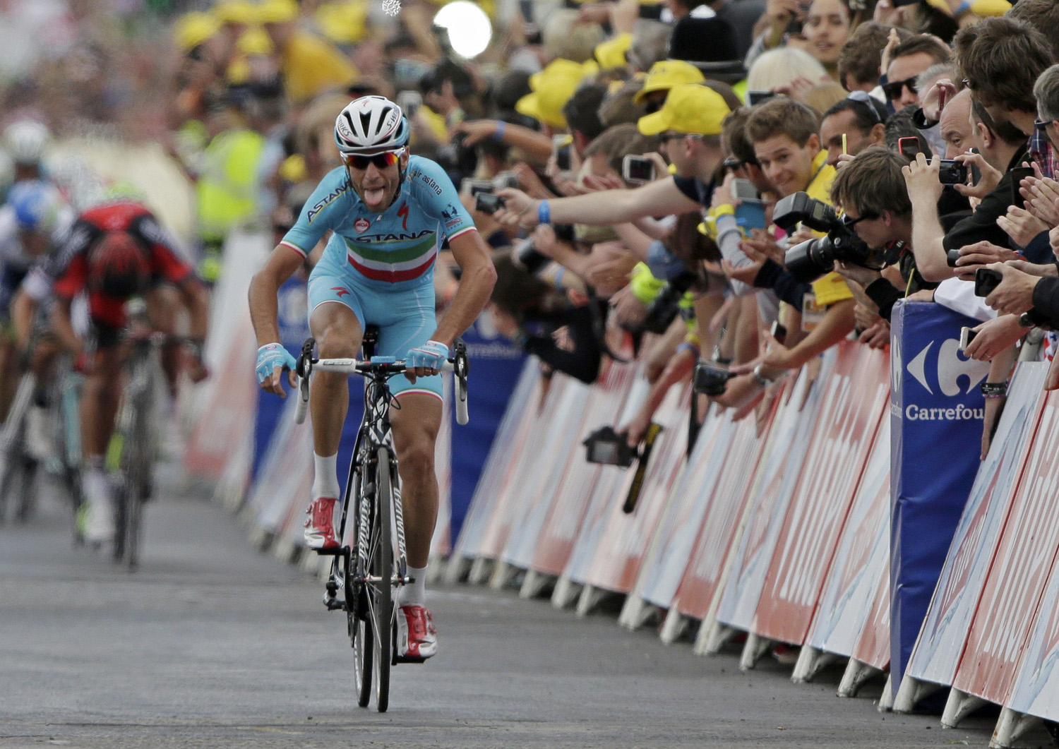 Astana team rider Vincenzo Nibali of Italy celebrates as he crosses the finish line to win  the second 201 km stage of  the Tour de France cycling race from York to Sheffield, France on July 6, 2014.