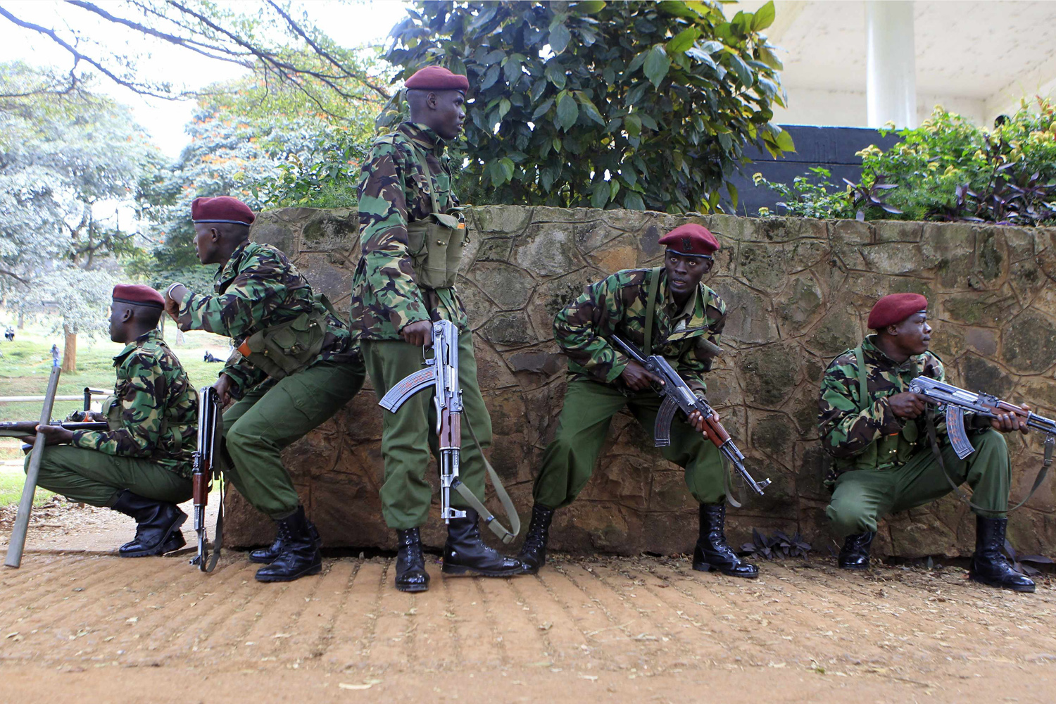 Jul. 7, 2014. Policemen from the General Service Unit (GSU) take cover from stone throwing youths during the  Saba Saba Day  rally at the Uhuru park grounds in the capital Nairobi.