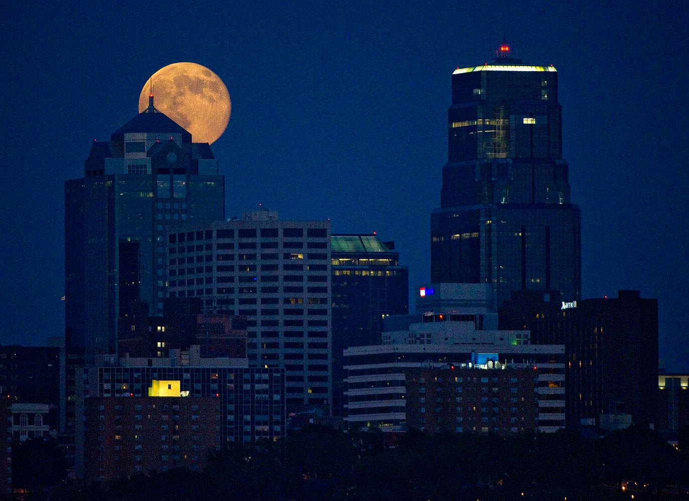 The Supermoon rises over downtown Kansas City, Missouri July 12, 2014.