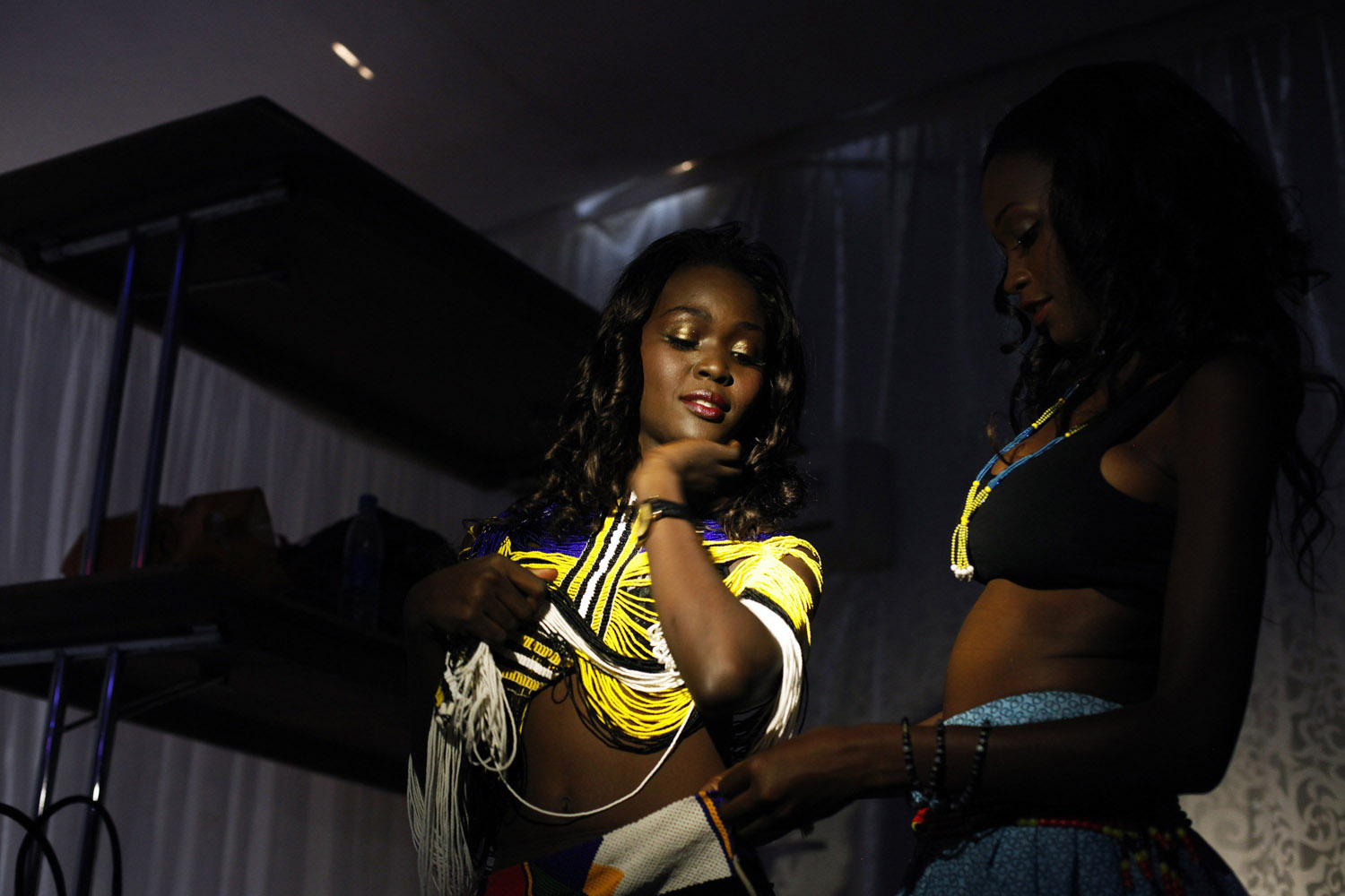 Jul. 13, 2014. Contestants adjust their traditional attire before going on stage for the  Beauties of South Sudan  beauty contest in Juba.