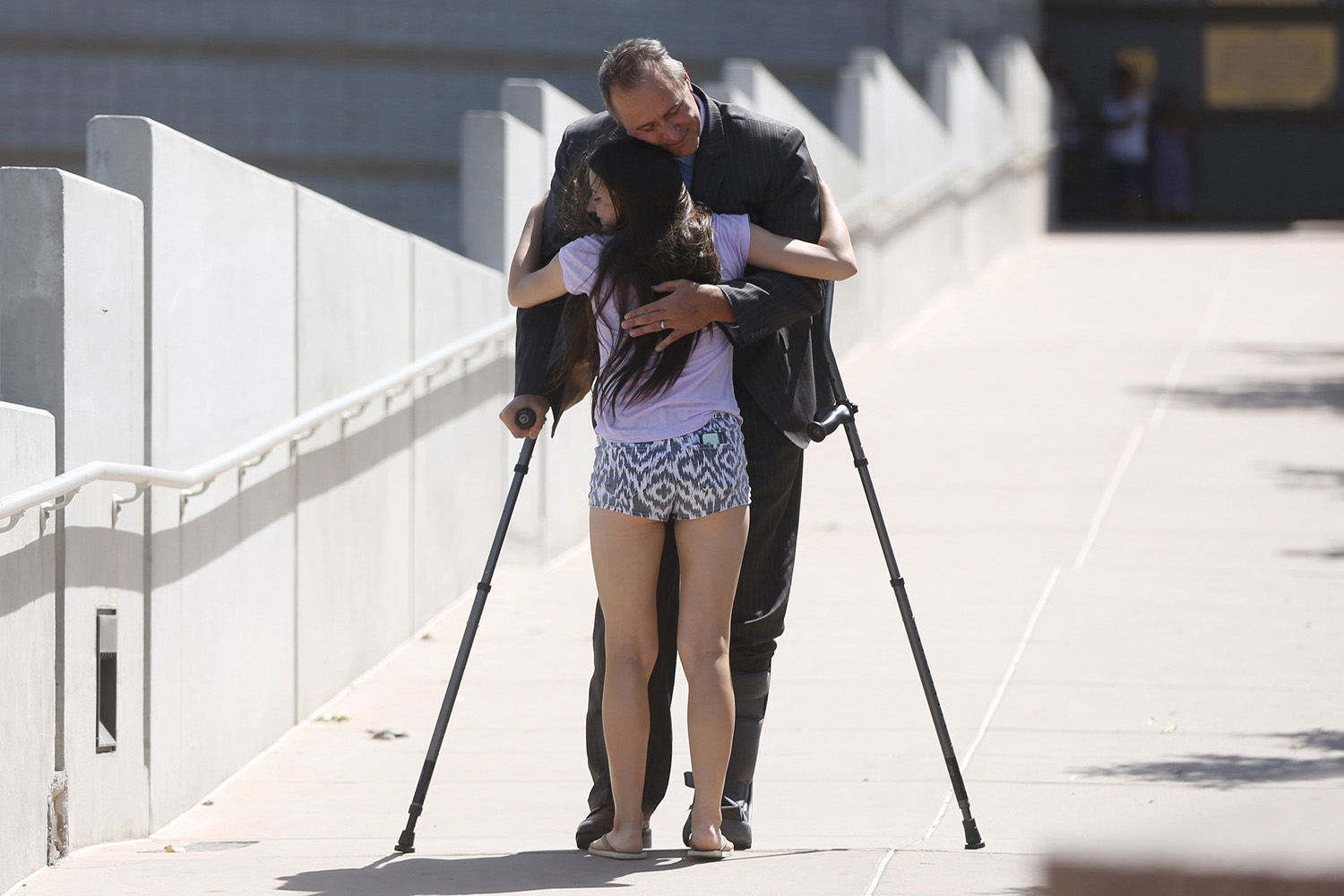 Former Attorney General Mark Shurtleff hugs his daughter Annie Shurtleff as he leaves after being booked at the Salt Lake County Metro Jail in South Salt Lake City, Utah on July 15, 2014.