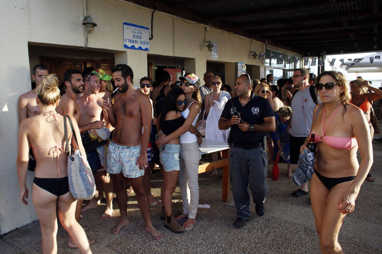 Jul. 15, 2014. Beach-goers take shelter as a siren sounds warning of incoming rockets in Tel Aviv. An Israeli civilian was killed by a rocket fired from the Gaza Strip on Tuesday, the military said, the first Israeli fatality in more than a week of fighting with Palestinian militants.