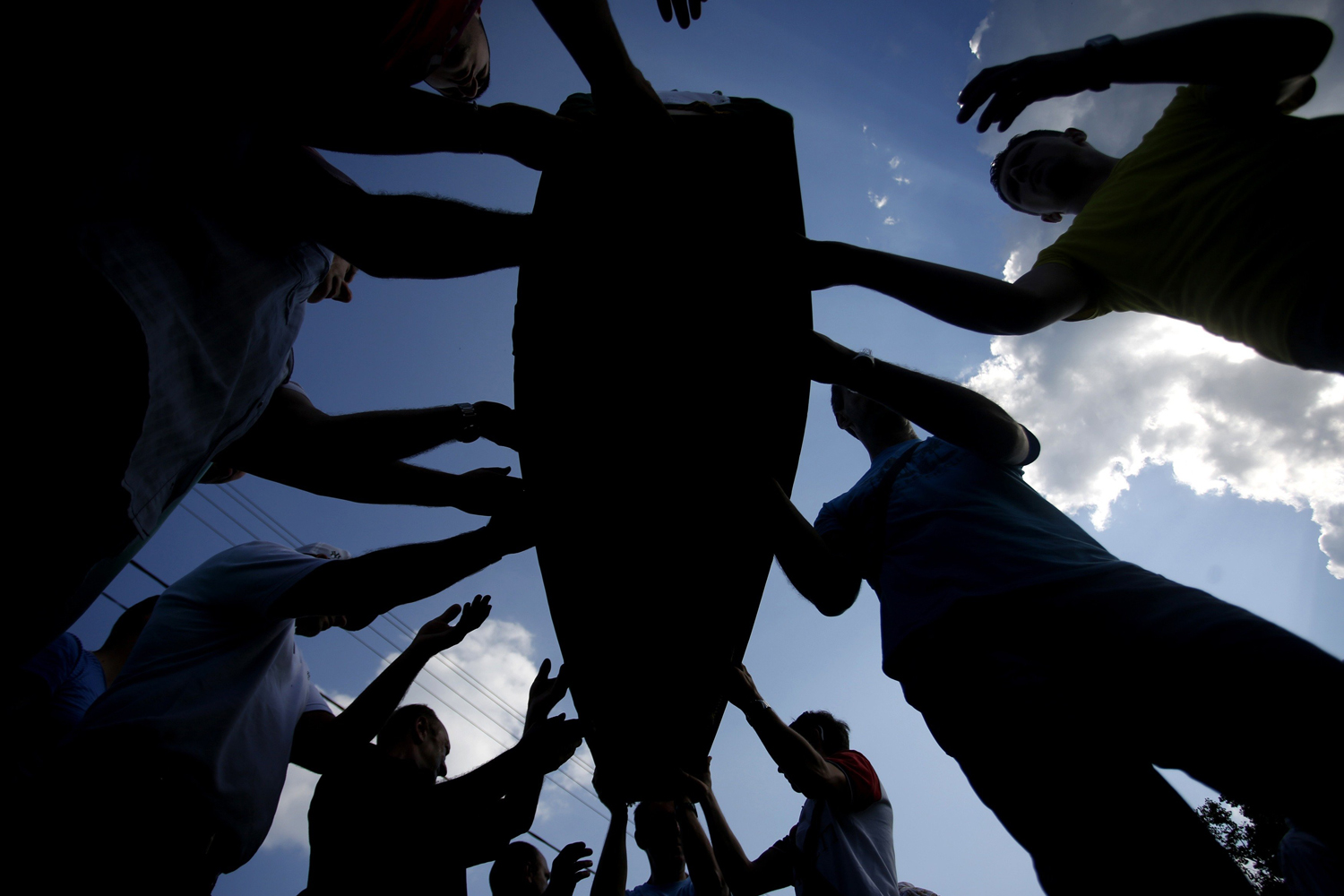 Jul. 19, 2014. Bosnian Muslims carry coffins with bodies from a mass grave, before a mass funeral in Kozarac, near Prijedor.