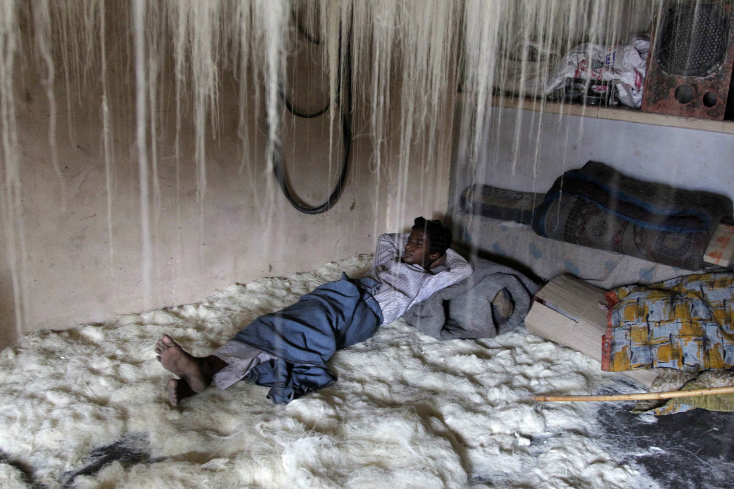 Jul. 22, 2014.A worker rests on vermicelli inside a factory in the northern Indian city of Allahabad.