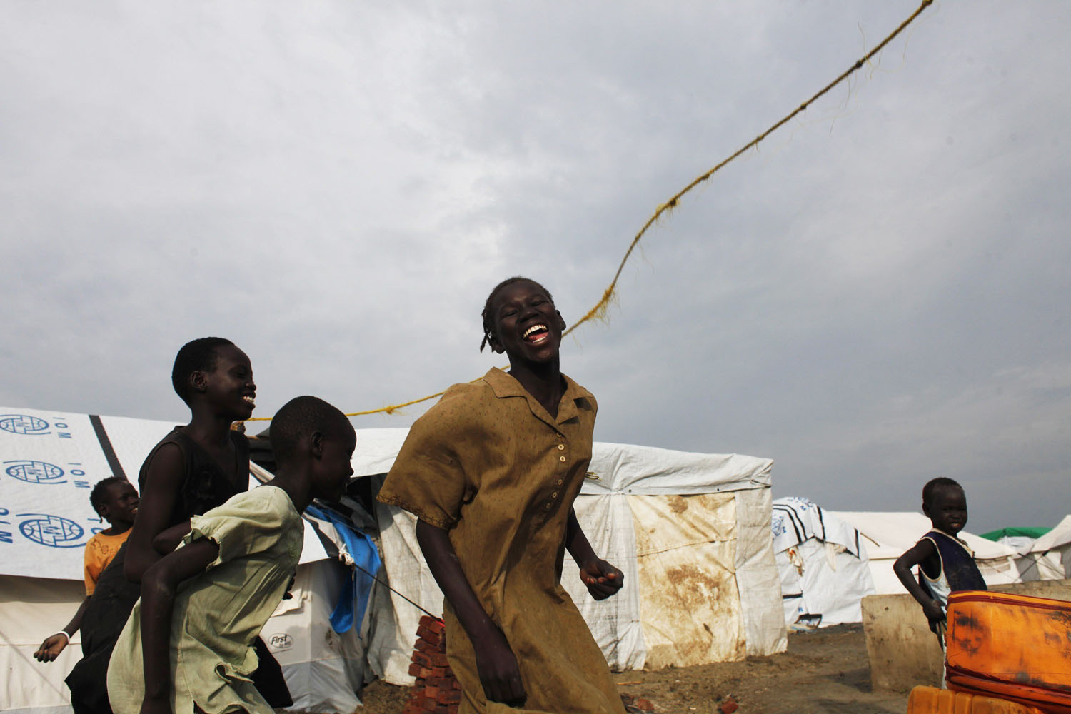 Jul. 24, 2014. Girls play in an internally displaced persons (IDP) camp inside the U.N. base in Malakal, South Sudan.